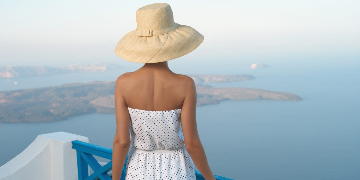 Fashion photo of a romantic lady looking at the sea