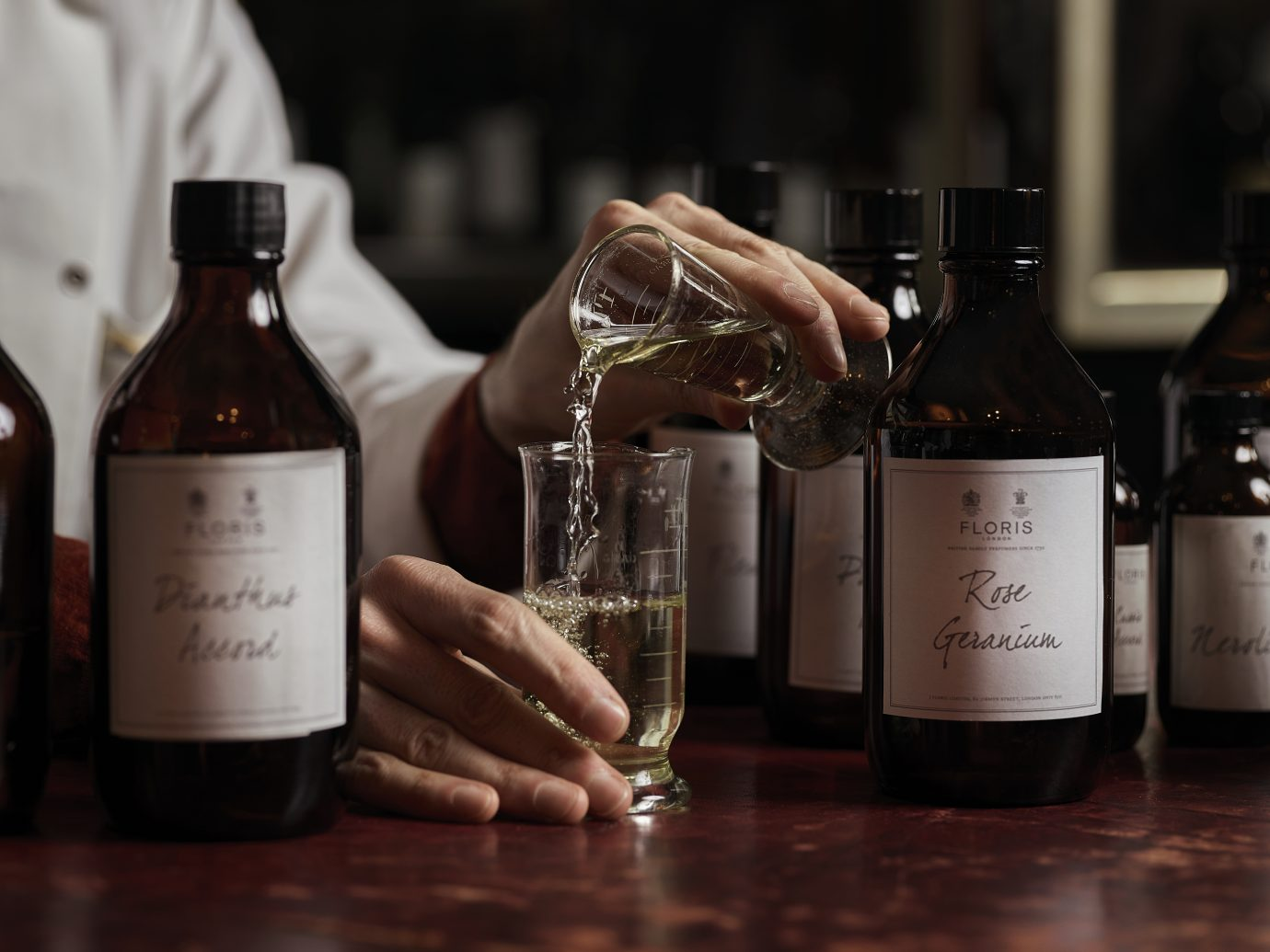Person mixing fragrances at Floris in London