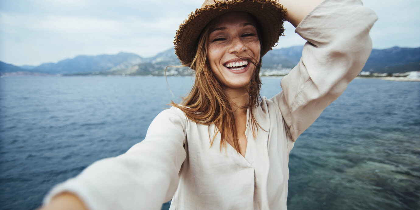 Young woman doing selfie on a vacation