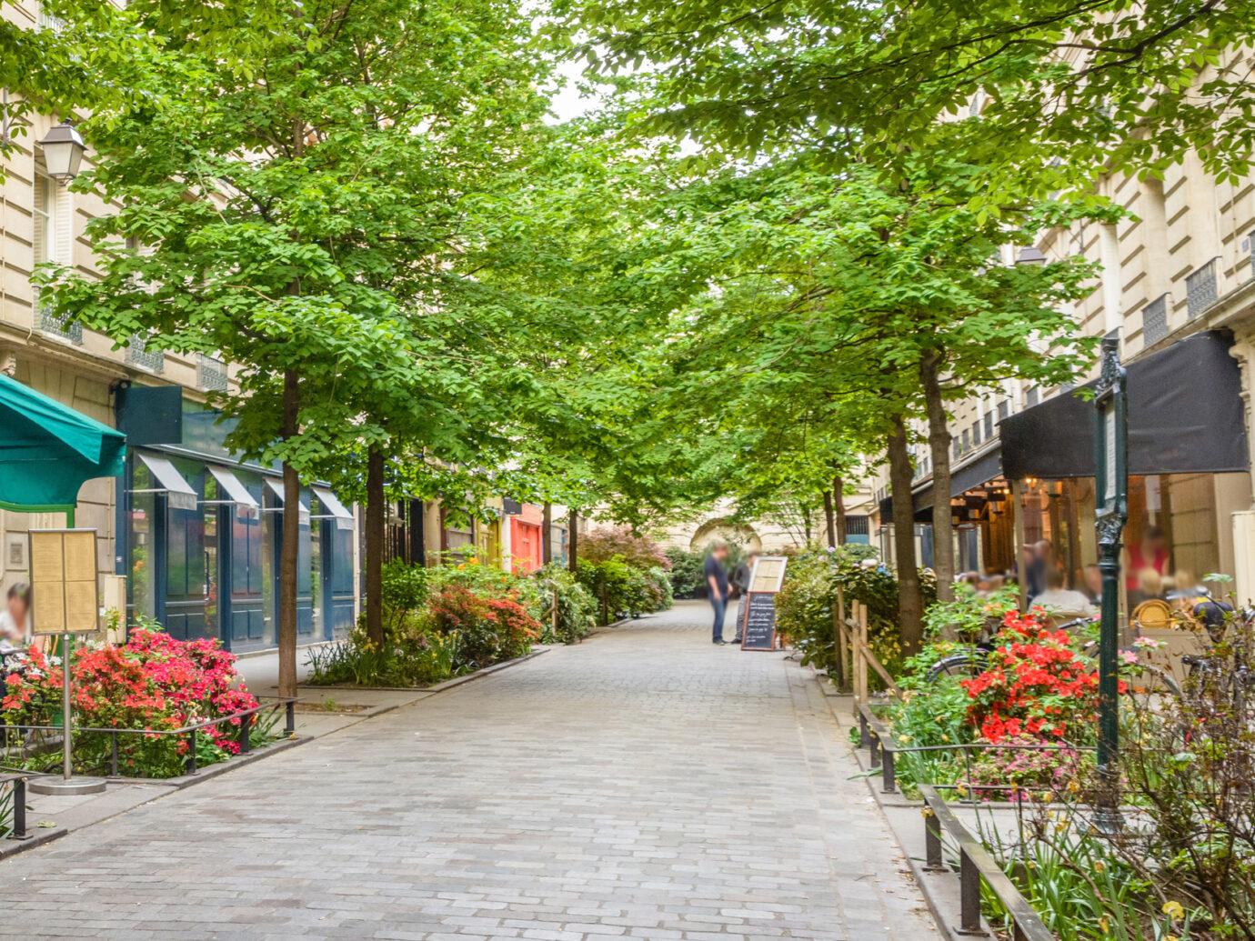 A quiet street with restaurants in the bohemian Marais district of Paris.