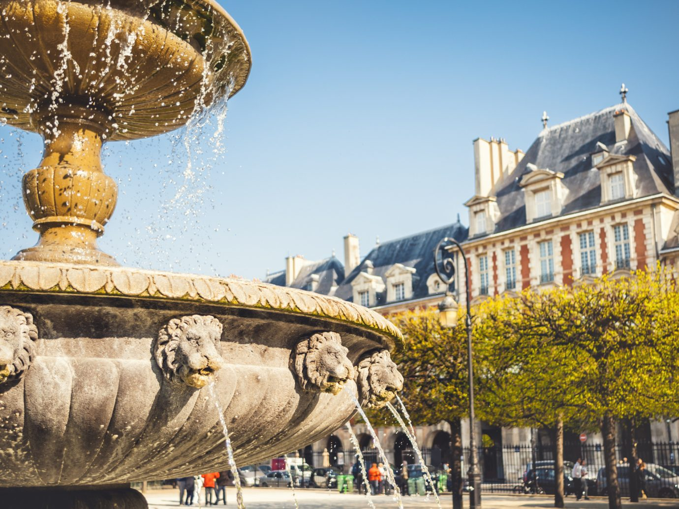 Fontain on the Place des Vosges in Paris. Toned picture.