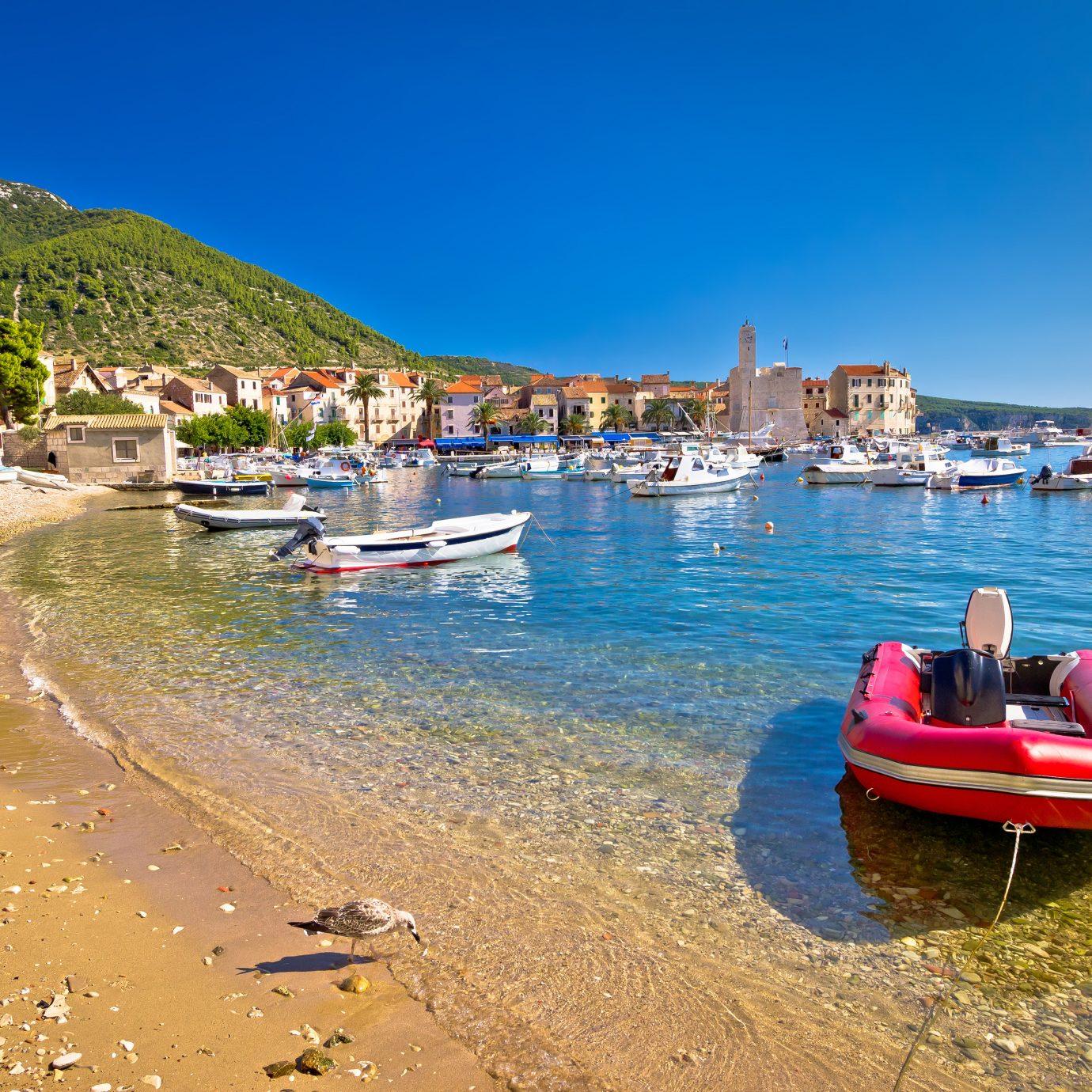 Sand beach in Komiza fishermen village, Island of Vis, Croatia
