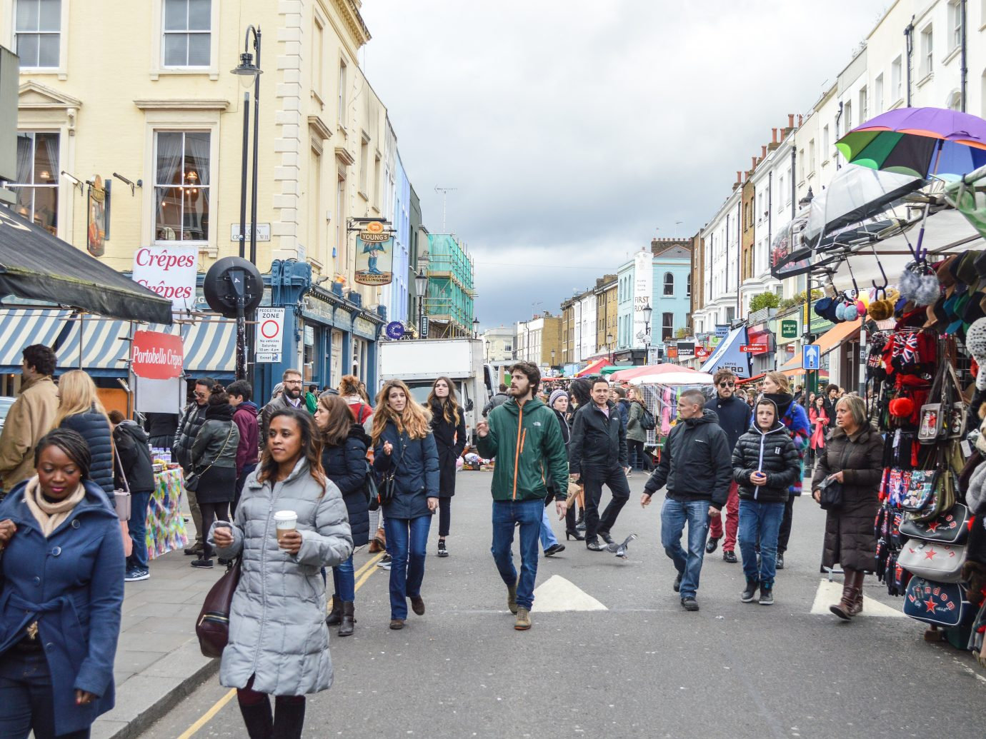 People shopping at Portobello Road Market in Notting Hill