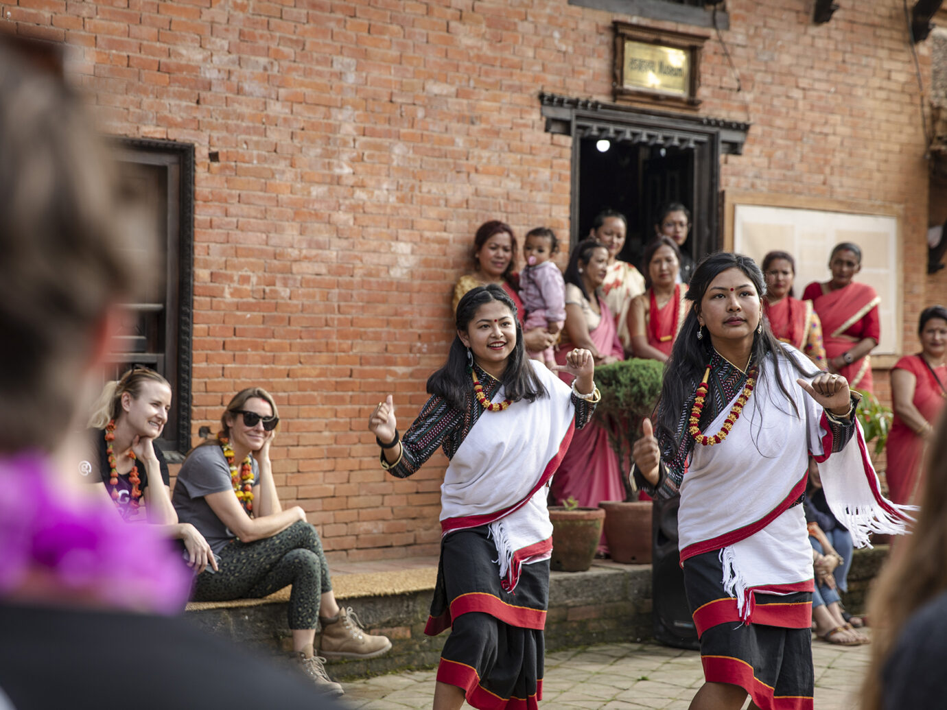 Women dancing in traditional Indian clothing in Agra