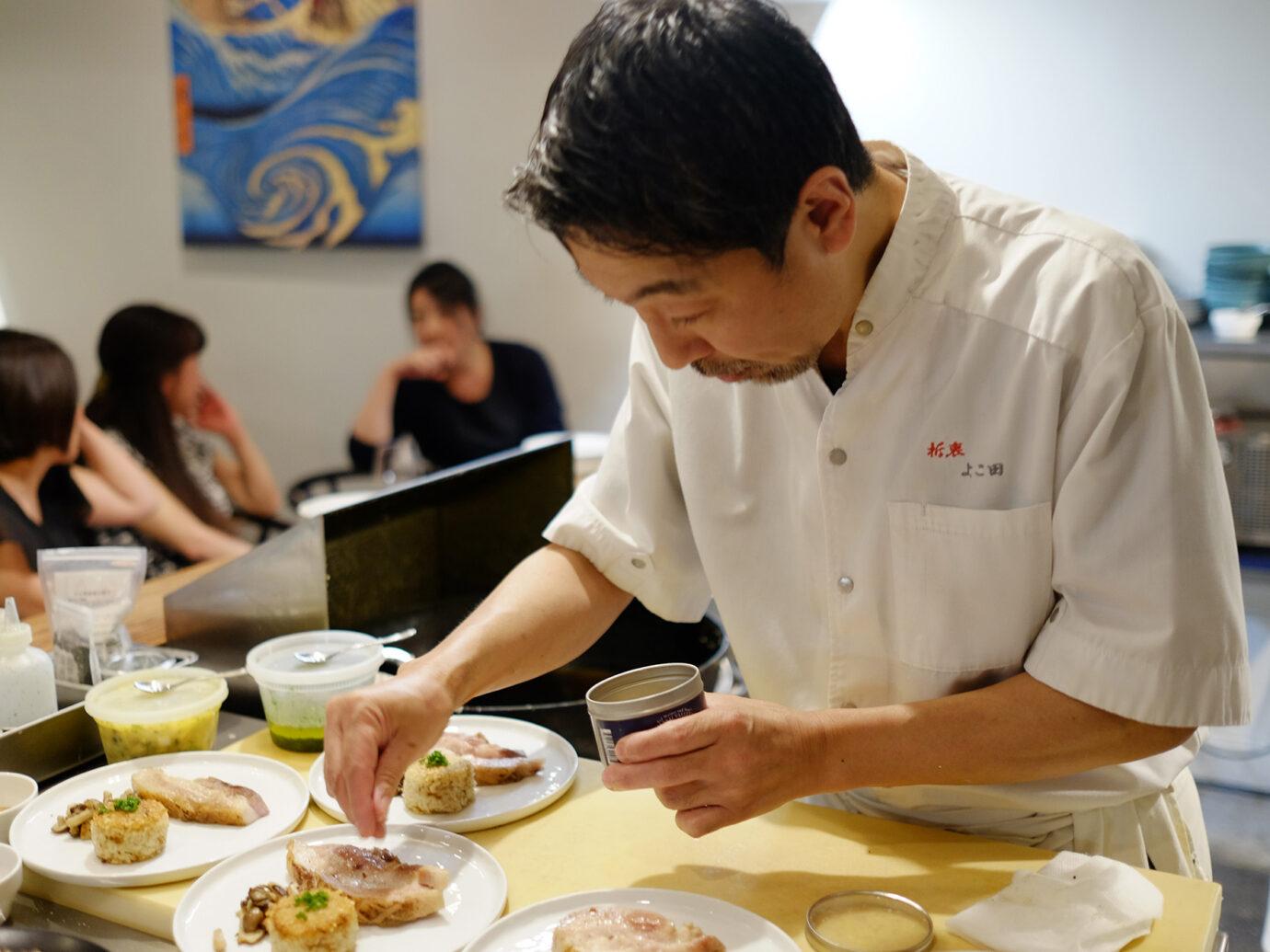 Chef plating dishes at Secchu Yokota