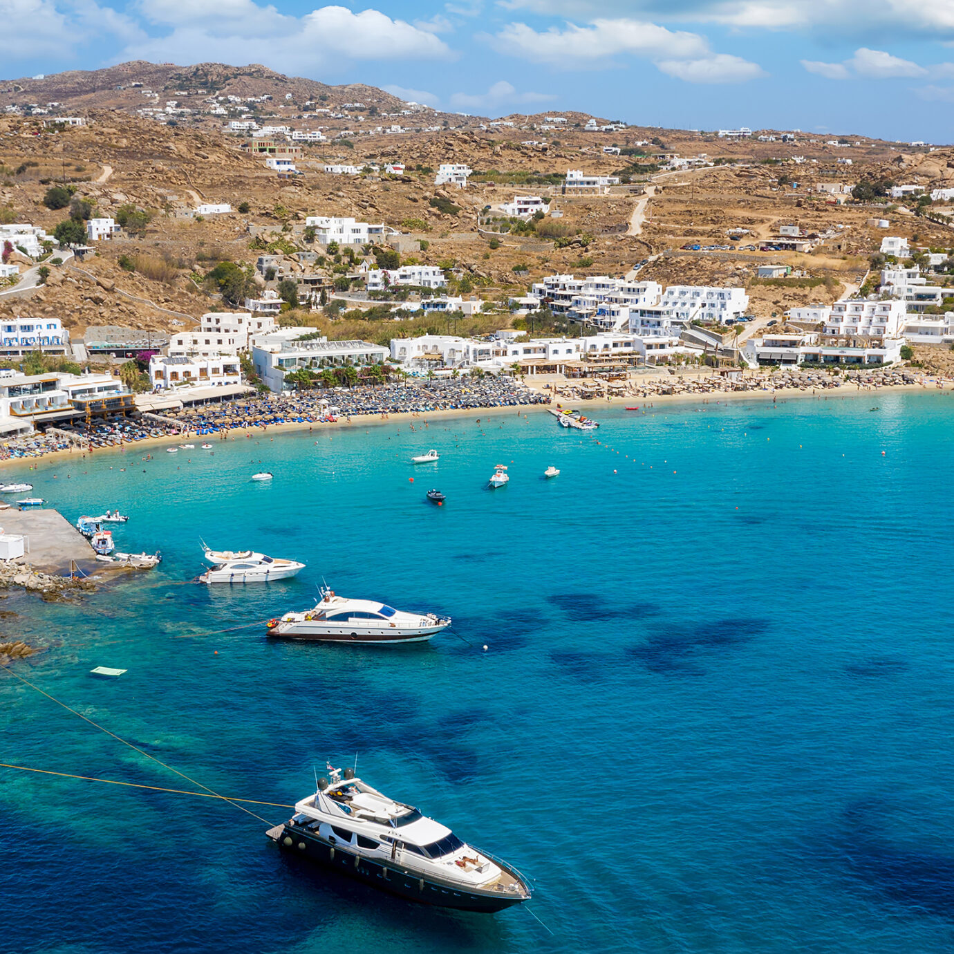 Aerial view to the popular Platis Gialos beach on the island of Mykonos, Cyclades, Greece