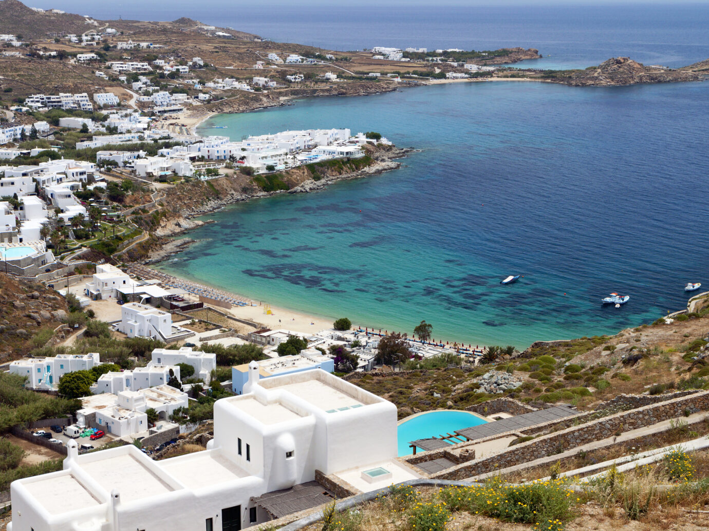 Platis gialos and the famous Psarou beach at Mykonos island in Greece