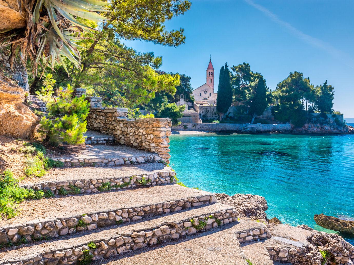 Old stone steps and blue water of Brac Island, Croatia