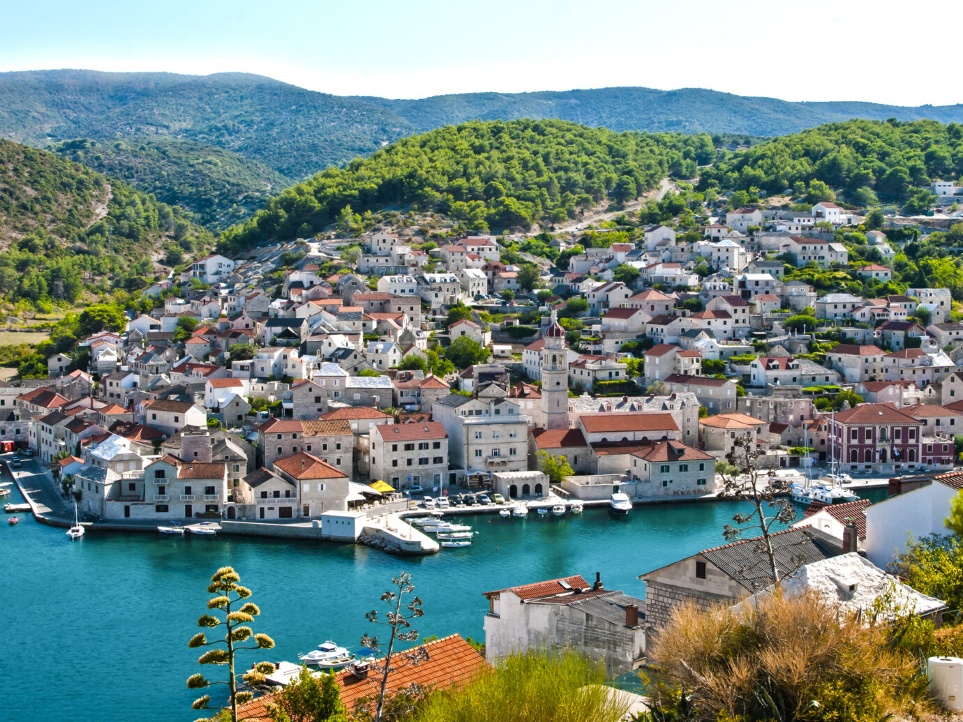 Pucisca, Croatia, Dalmatia - small romantic Croatian town located on the island of Brac, at the bay. Summer landscape with town and bay. Travel destination.