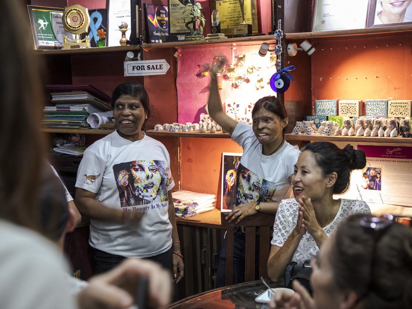 Sheroes Hangout employees interacting with Travellers