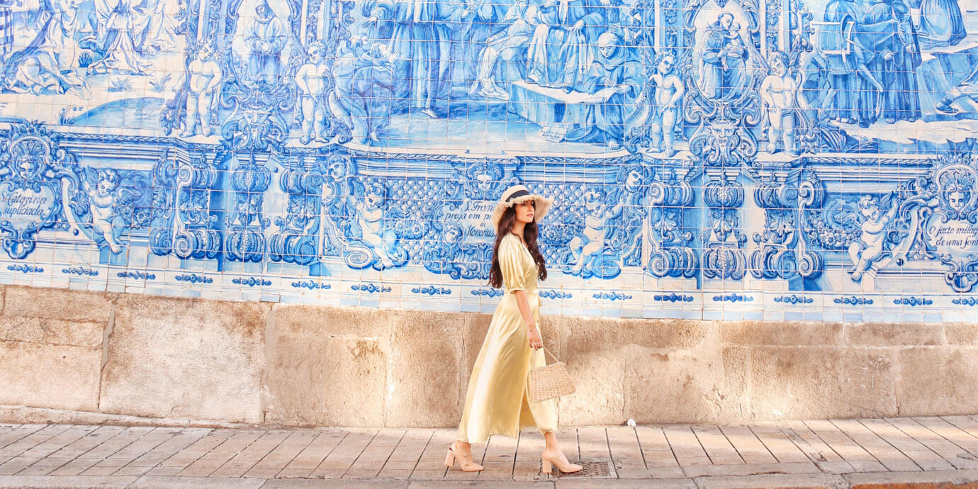 Anoushka Probyn in front of tile wall in Portugal