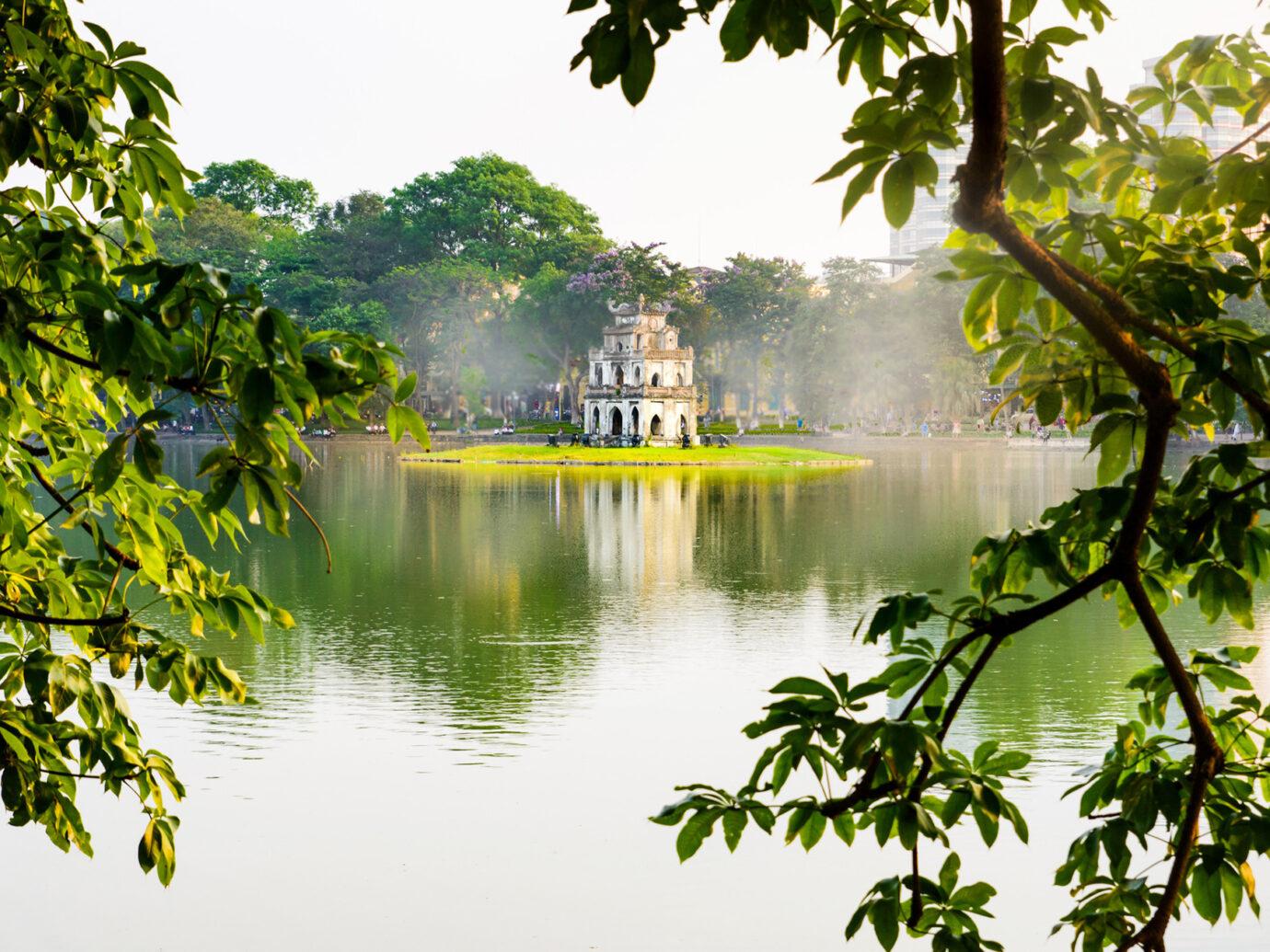 Turtle Tower in Hanoi Hoan Kiem foggy lake in Vietnam