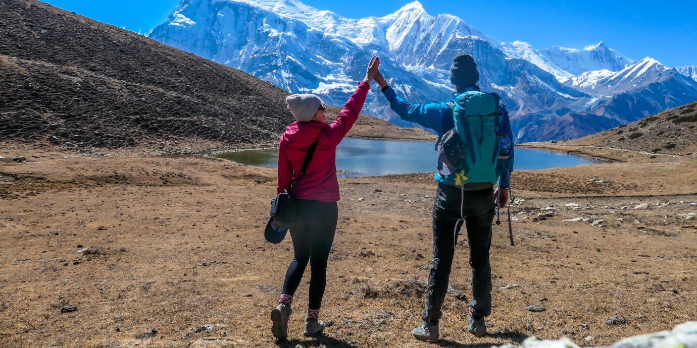 A couple dancing on the Annapurna Circuit Trek, Himalayas, Nepal.
