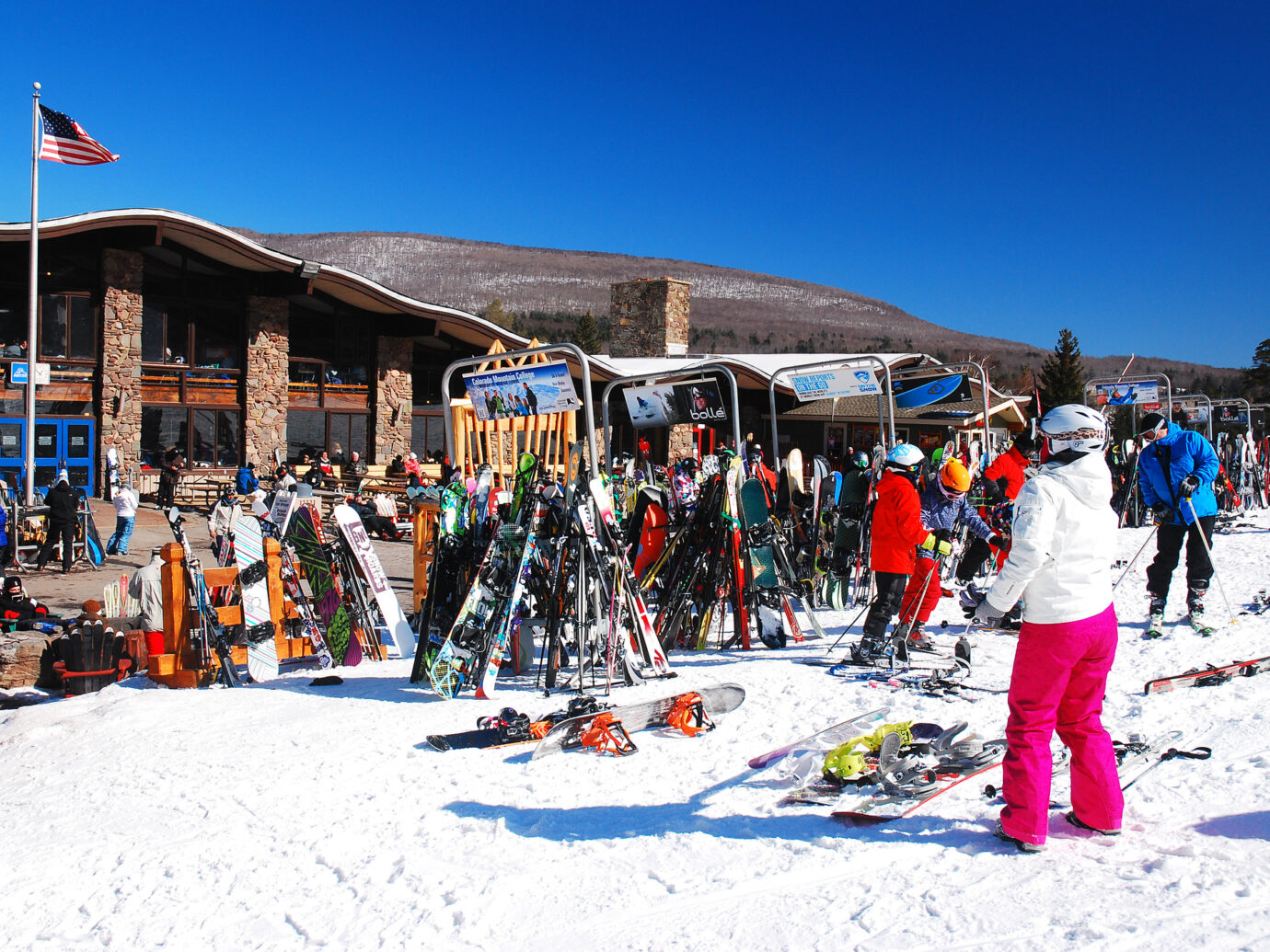 A young woman takes off her skis for a midday break at a ski resort in Hunter, New York