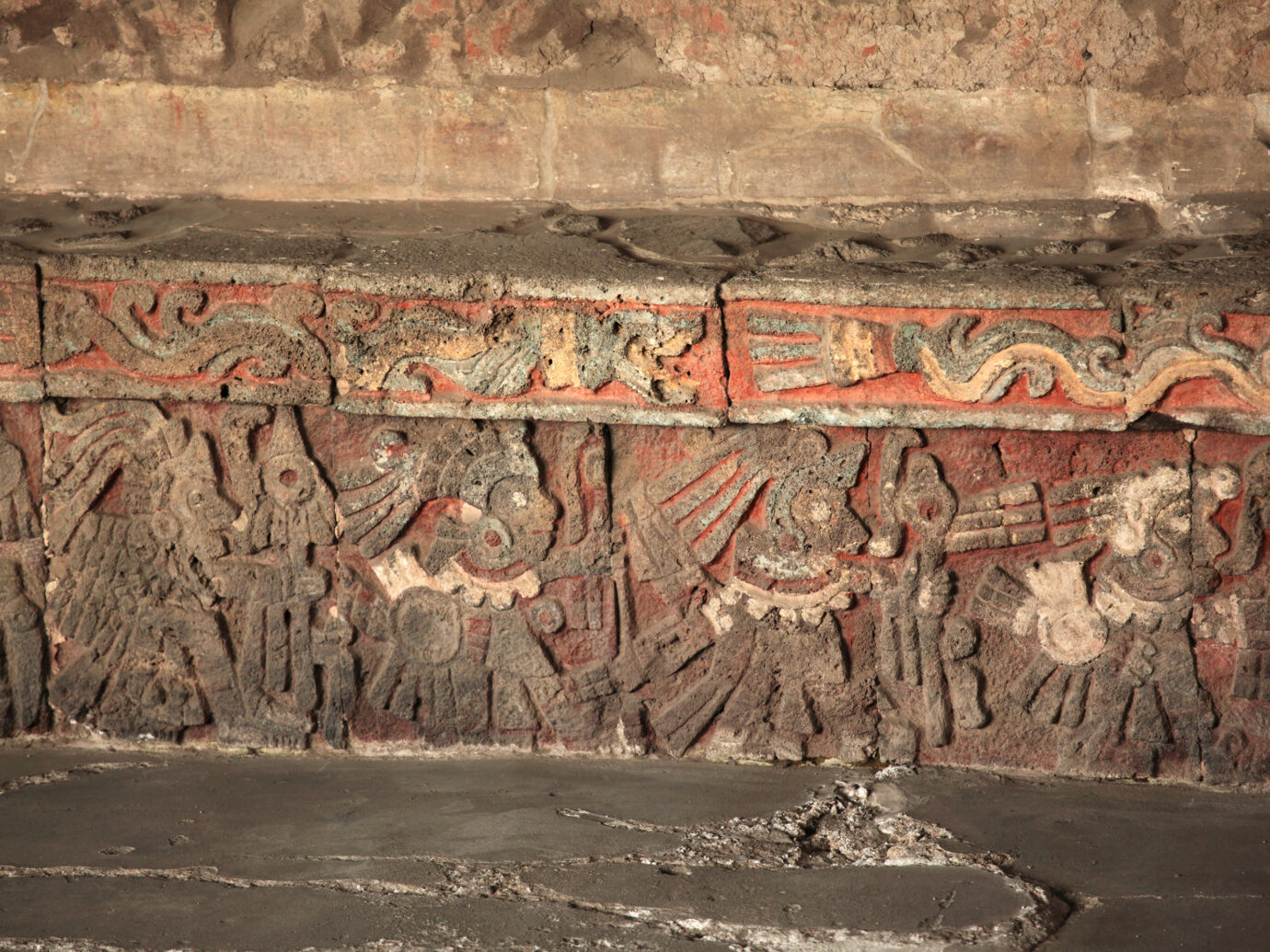 """""""Warriors Relief - Templo Mayor, Mexico CityWith bas relief images carved on stone. The images are painted on a red background.The images depict warriors converging to a ball of straw (heno, in Spanish) called zacatapayoli containing maguey thorns with their blood that were offered as penance."""""""