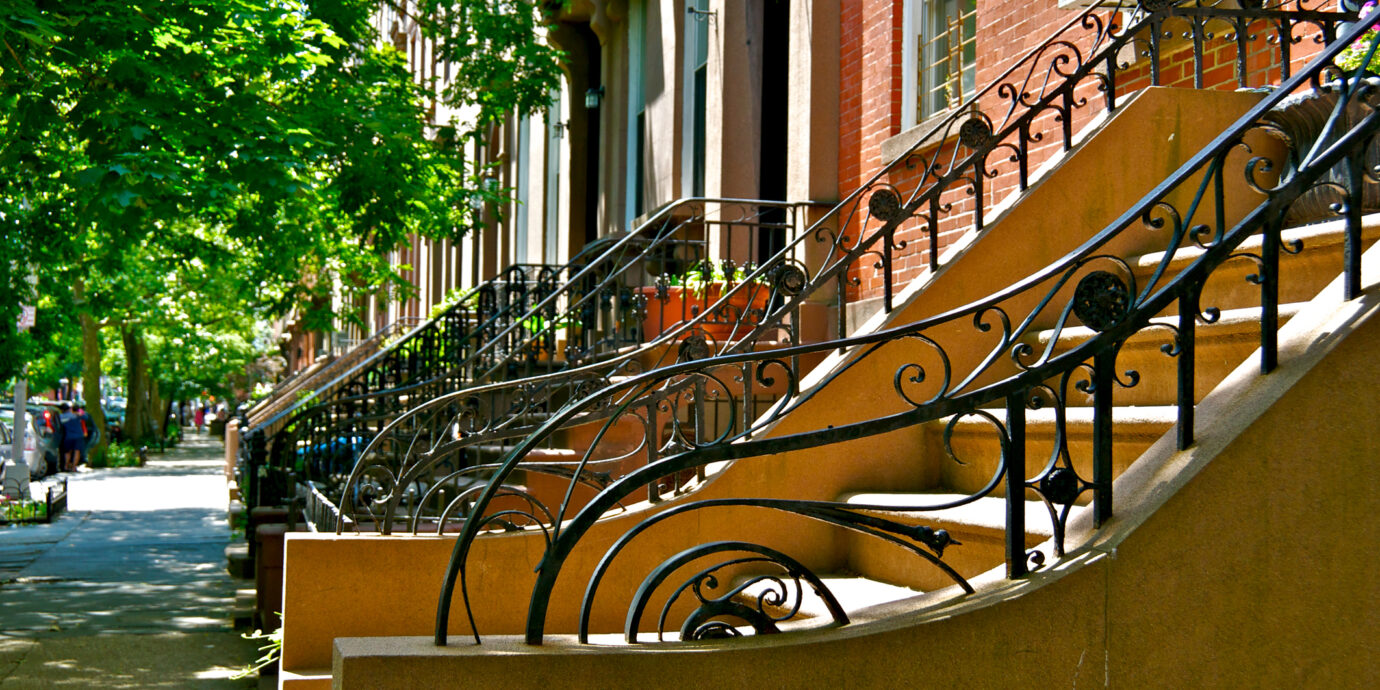 """A typical mix of different architectural styles of """"Brownstone"""" and brick row house residential buildings built c.1880's-1890's is seen in the Cobble Hill neighborhood of Brooklyn, New York City, USA."""