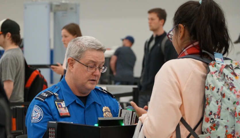 TSA checks ID for traveler