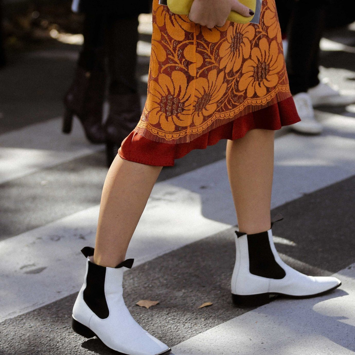 fashionable woman in white boots crossing the streeet on a fall day, fall boots, best boots for fall