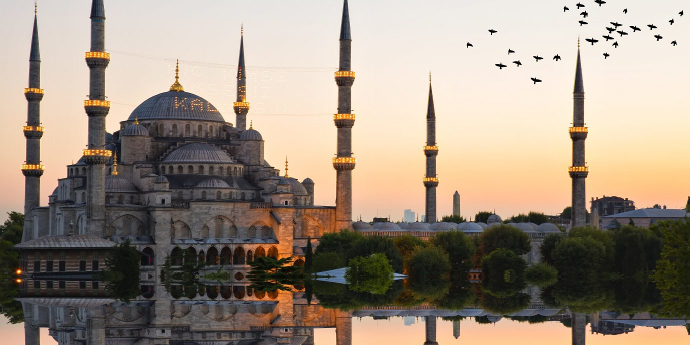 News sky outdoor reflection light mosque landmark traffic place of worship spire tourist attraction yellow building morning dome evening byzantine architecture City dusk historic site dawn metropolis cityscape tourism day