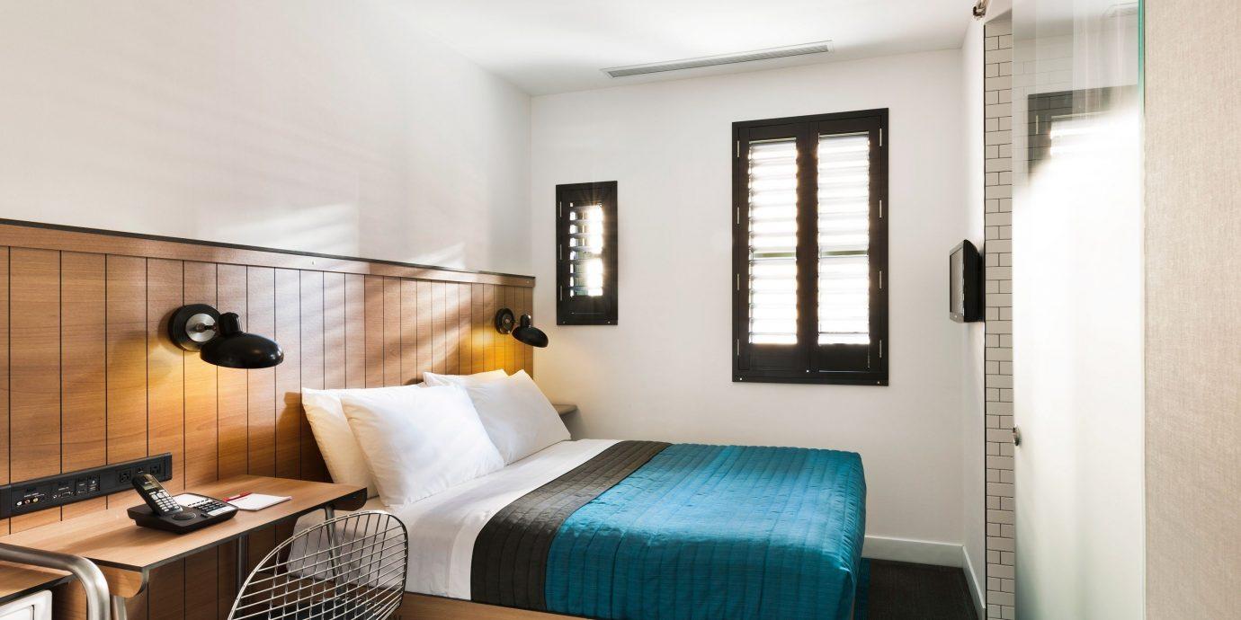 Travel Tips indoor wall floor room property Bedroom living room Suite interior design condominium home real estate estate cottage apartment Design furniture