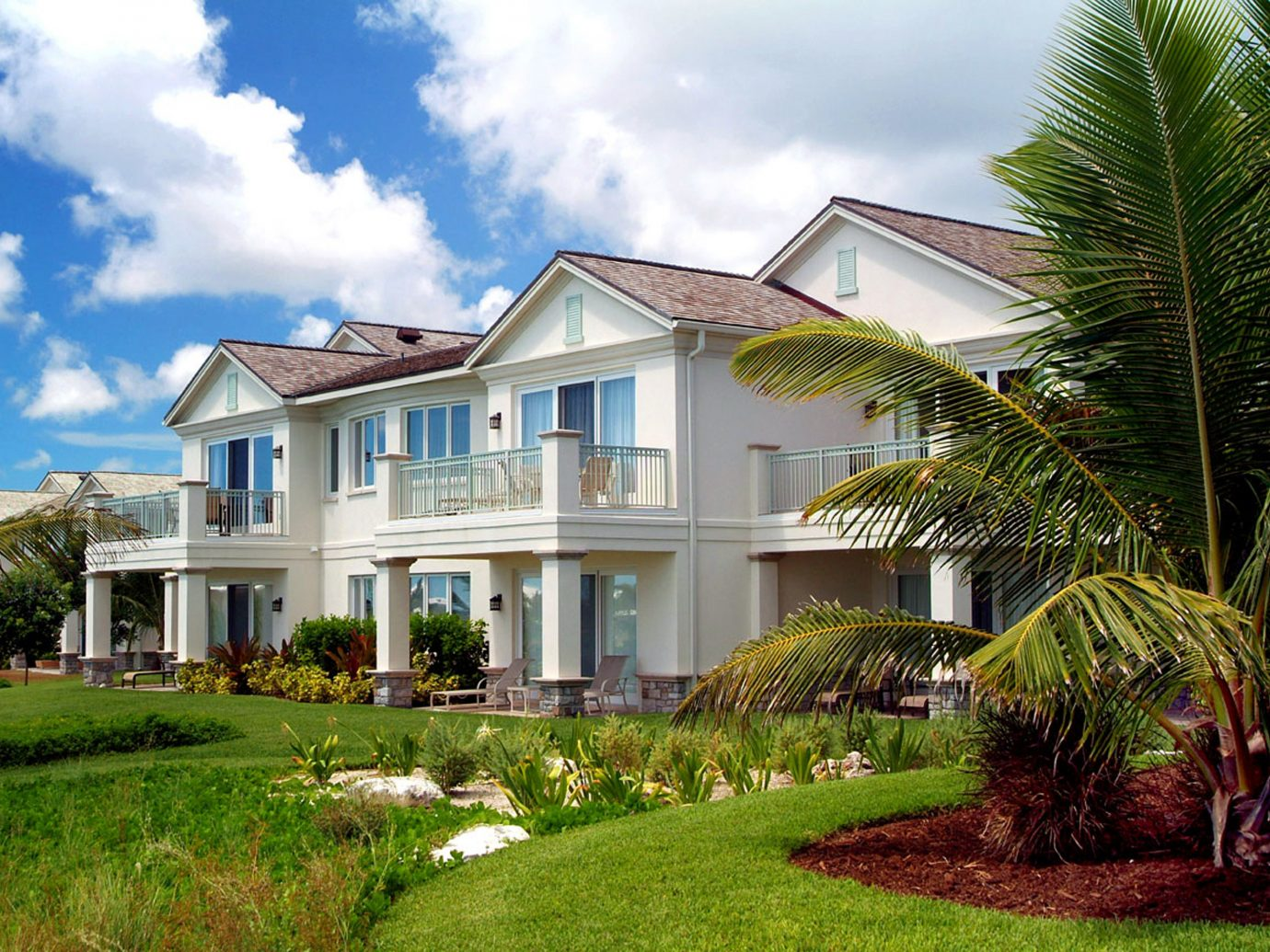 Buildings Grounds Honeymoon Hotels Luxury Resort Romance grass sky outdoor house property home estate building residential area real estate condominium neighbourhood mansion facade Villa backyard lawn cottage suburb farmhouse plantation residential lush Garden