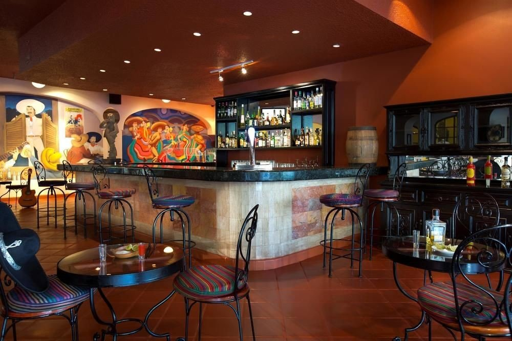 All-Inclusive Resorts Hotels ceiling indoor floor Bar room restaurant recreation room interior design estate furniture area
