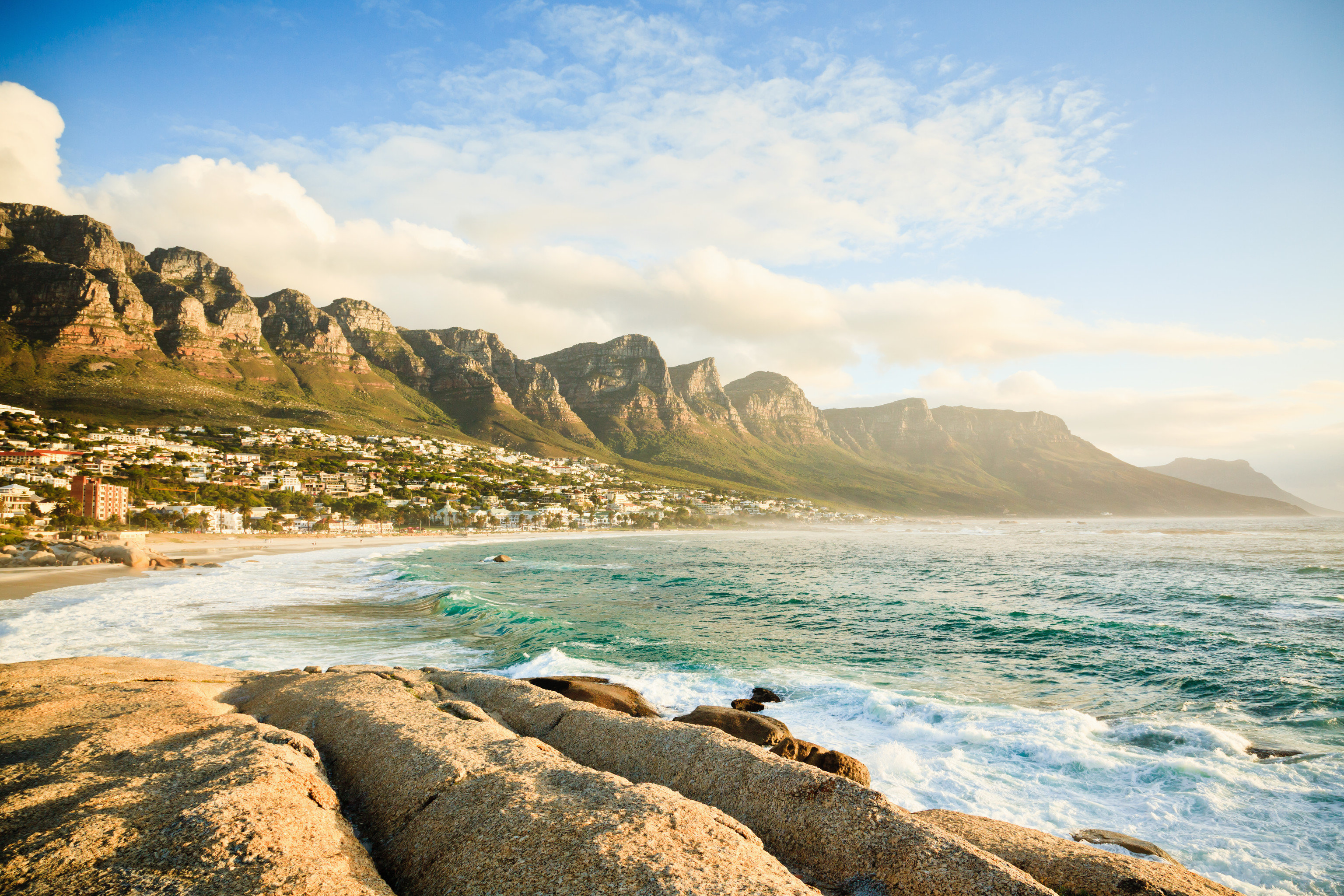 Hotels Trip Ideas outdoor sky rock mountain water Nature Sea shore Coast rocky body of water Beach Ocean cloud horizon vacation wave morning bay wind wave landscape cape cliff cove terrain sand sunlight material overlooking sandy highland