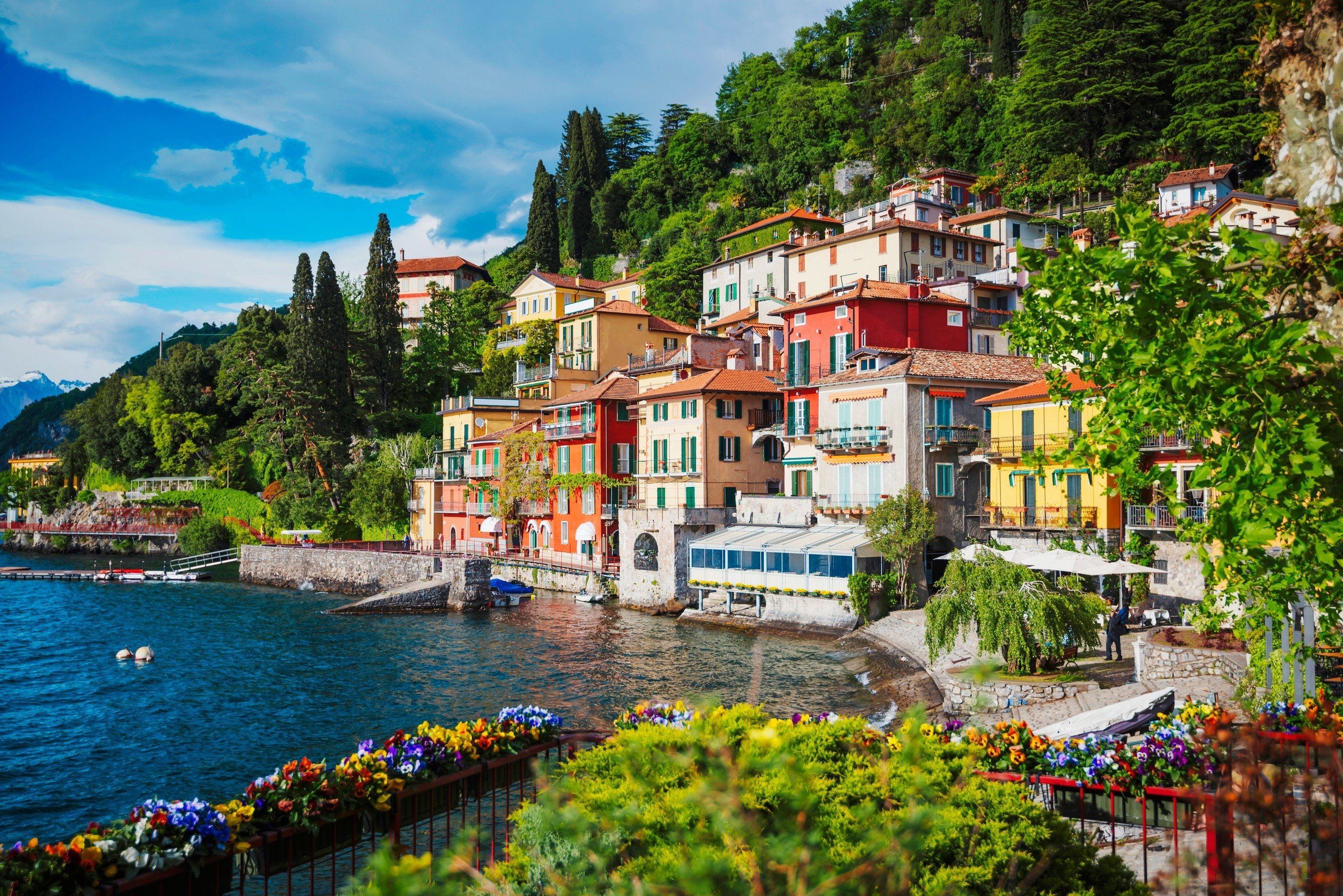 Jetsetter Guides tree outdoor water Town geographical feature landform scene Boat Village vacation human settlement River tourism Harbor Coast waterway Sea cityscape colorful surrounded