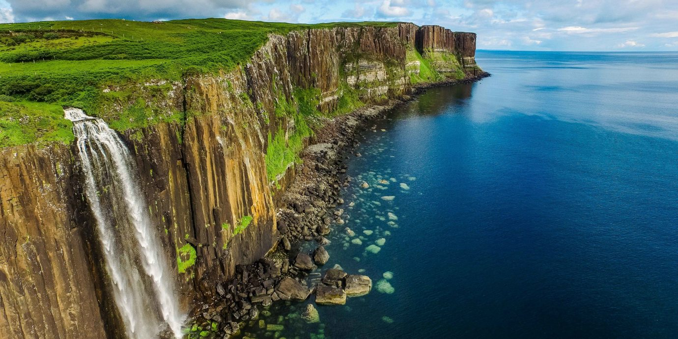 Trip Ideas Nature water outdoor cliff Coast promontory Waterfall headland sky terrain water resources coastal and oceanic landforms River water feature escarpment Sea watercourse klippe bay cove cape formation Lake surrounded