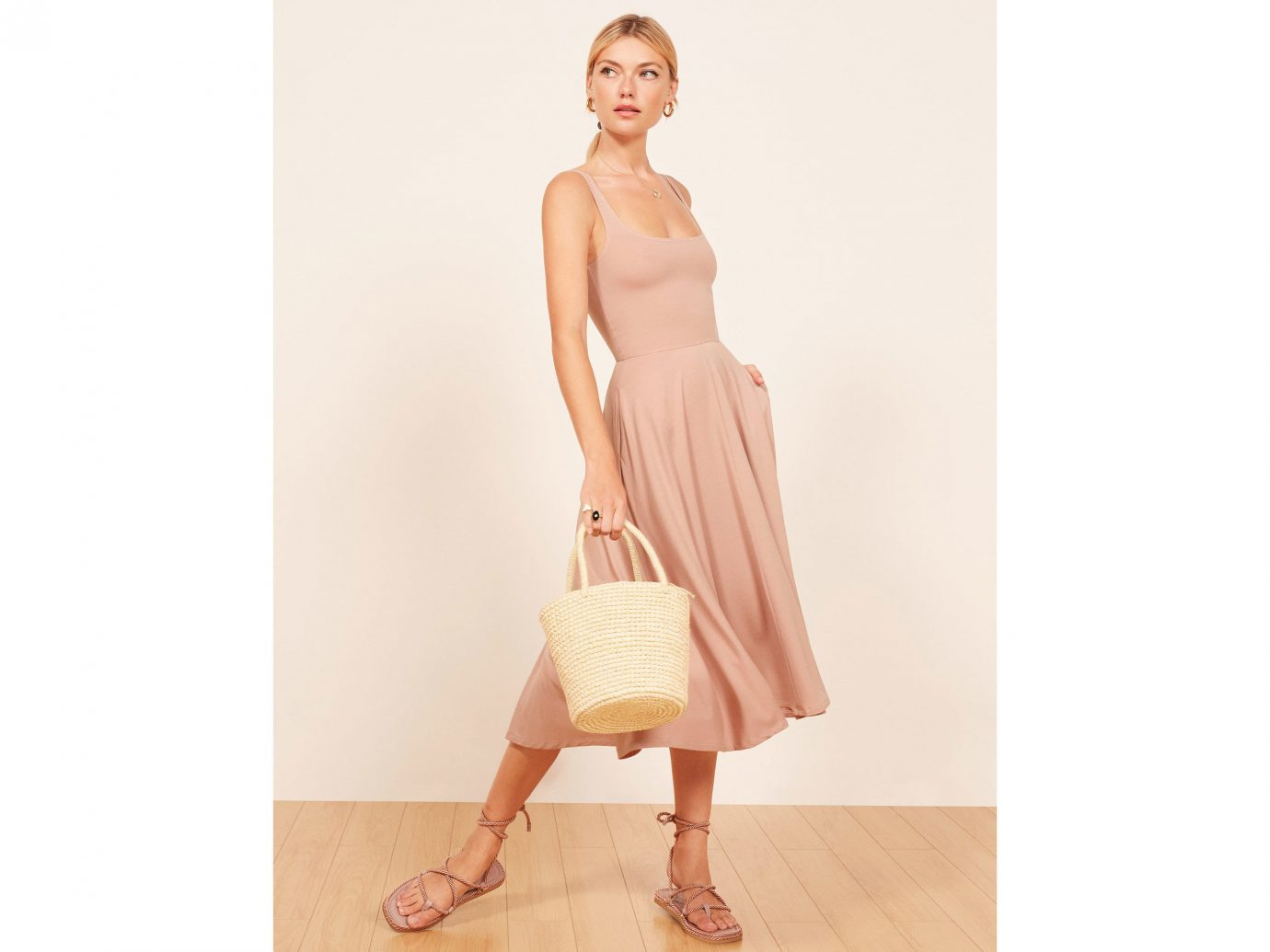 Style + Design Travel Shop wall clothing fashion model indoor shoulder dress shoe day dress peach supermodel beige cocktail dress joint neck waist posing tan