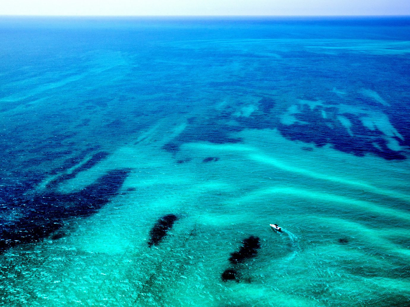 Beach water outdoor geographical feature Nature landform marine biology reef Sea Ocean wind wave wave Coast cape coral reef Island blue ocean floor