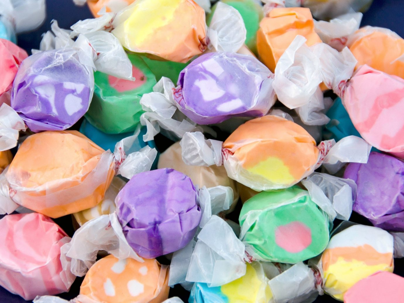 Food + Drink color pink food flower petal dessert taffy confectionery plastic containing colored