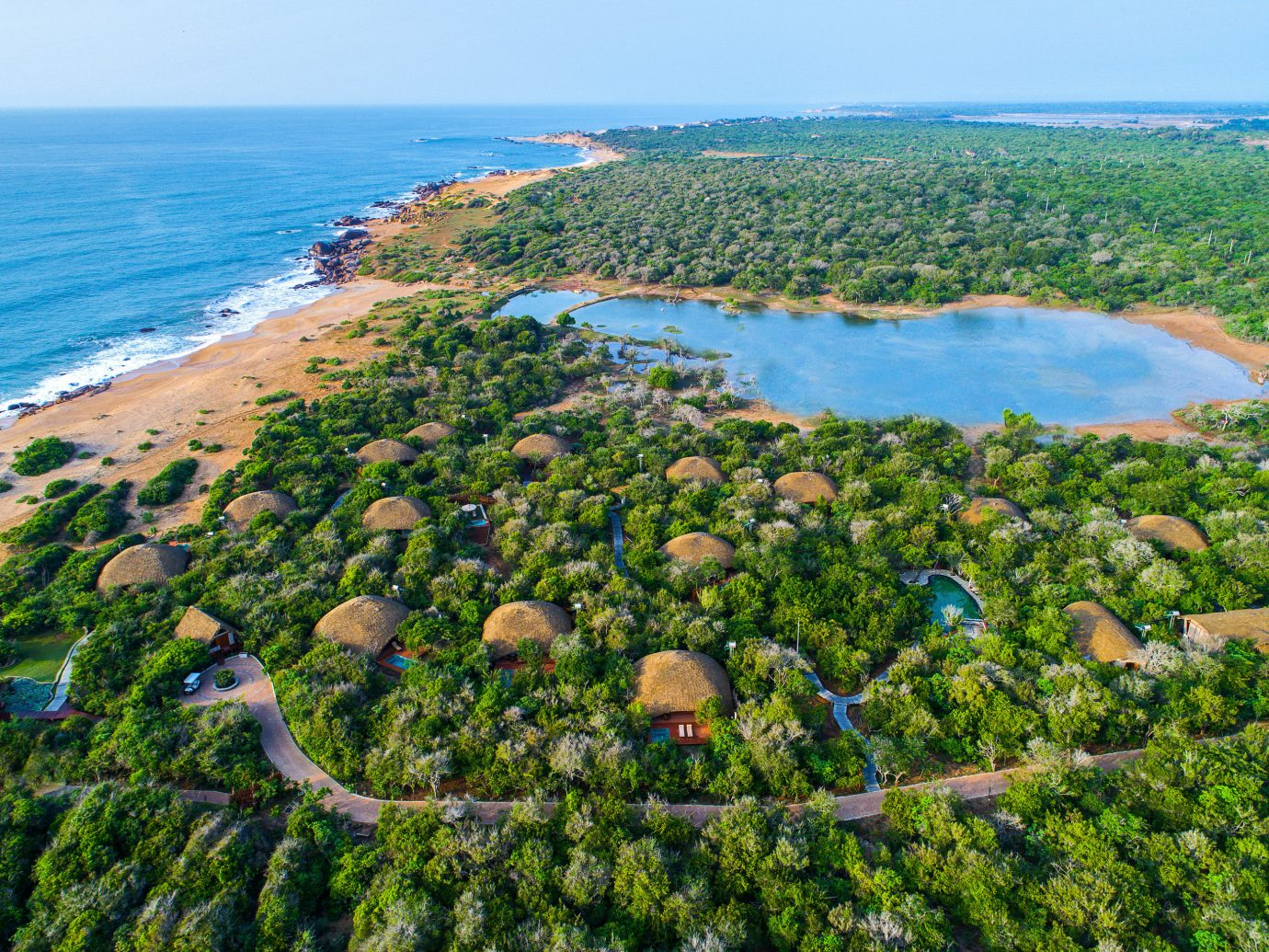 All-Inclusive Resorts Hotels Luxury Travel outdoor sky water vegetation Nature Coast nature reserve promontory Sea aerial photography bird's eye view bay reef tree tourism shore