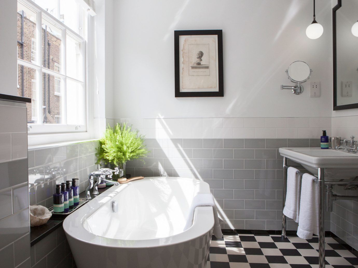 Budget Hotels London wall indoor bathroom floor room property window home white black interior design cottage bathtub estate Design tub sink real estate flooring apartment bidet toilet tile Bath tiled decorated