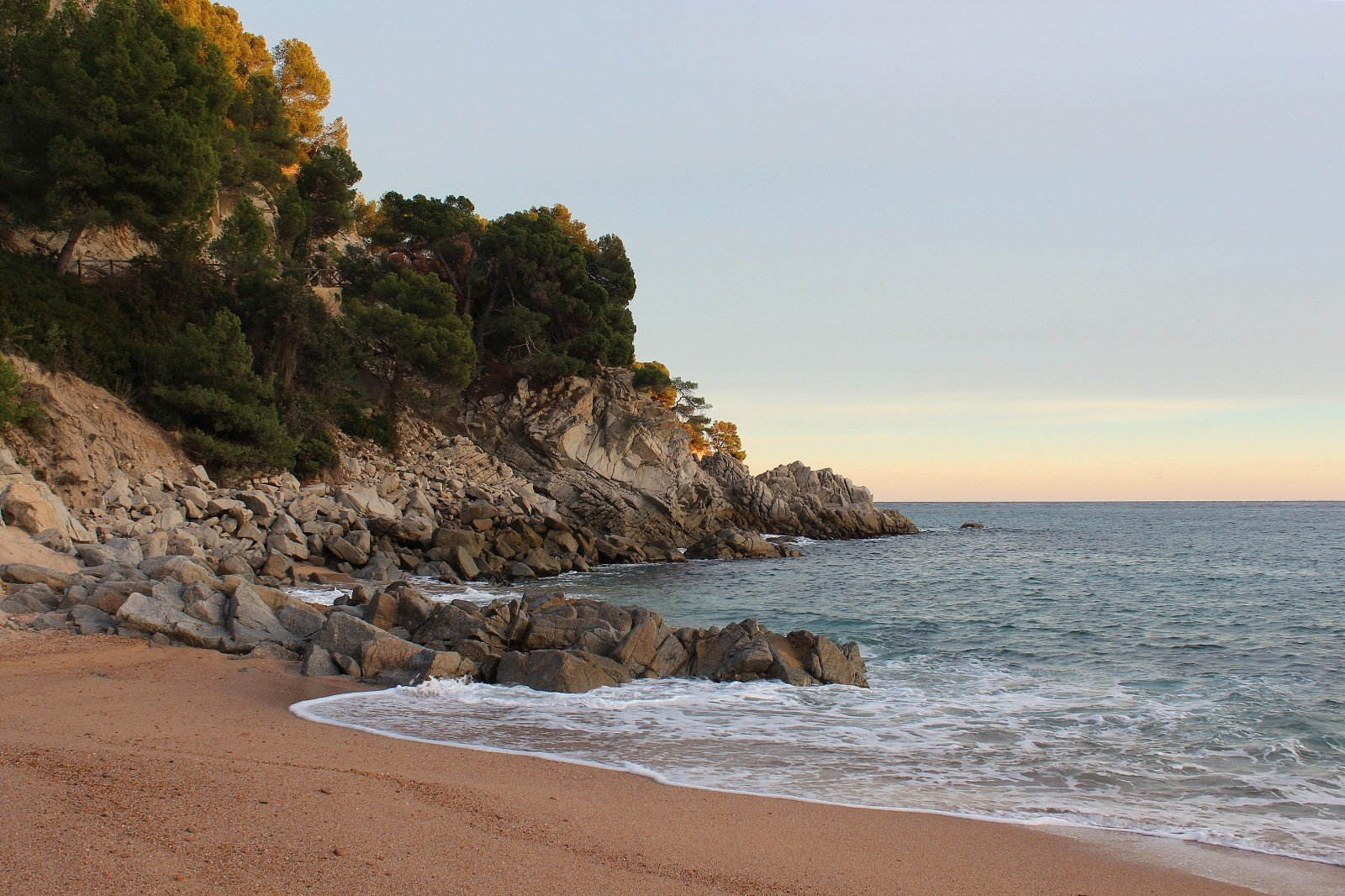 Offbeat outdoor sky water Nature Beach Coast shore body of water Sea Ocean rock cliff bay vacation sand wave cape wind wave terrain cove material sandy