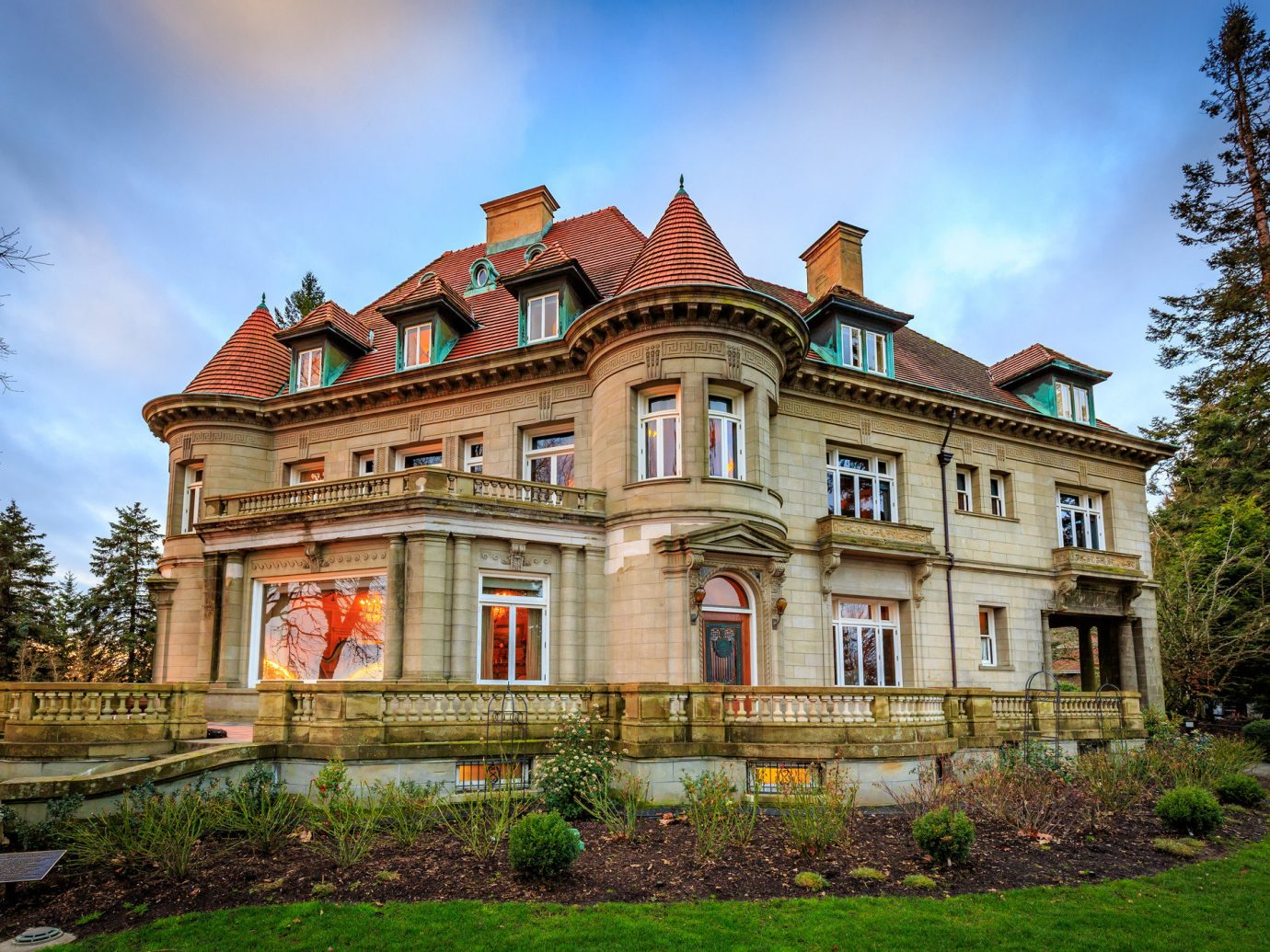 Health + Wellness Trip Ideas sky grass outdoor tree house building estate stately home château mansion home landmark manor house Architecture old historic house facade palace residential area real estate Villa stone government building