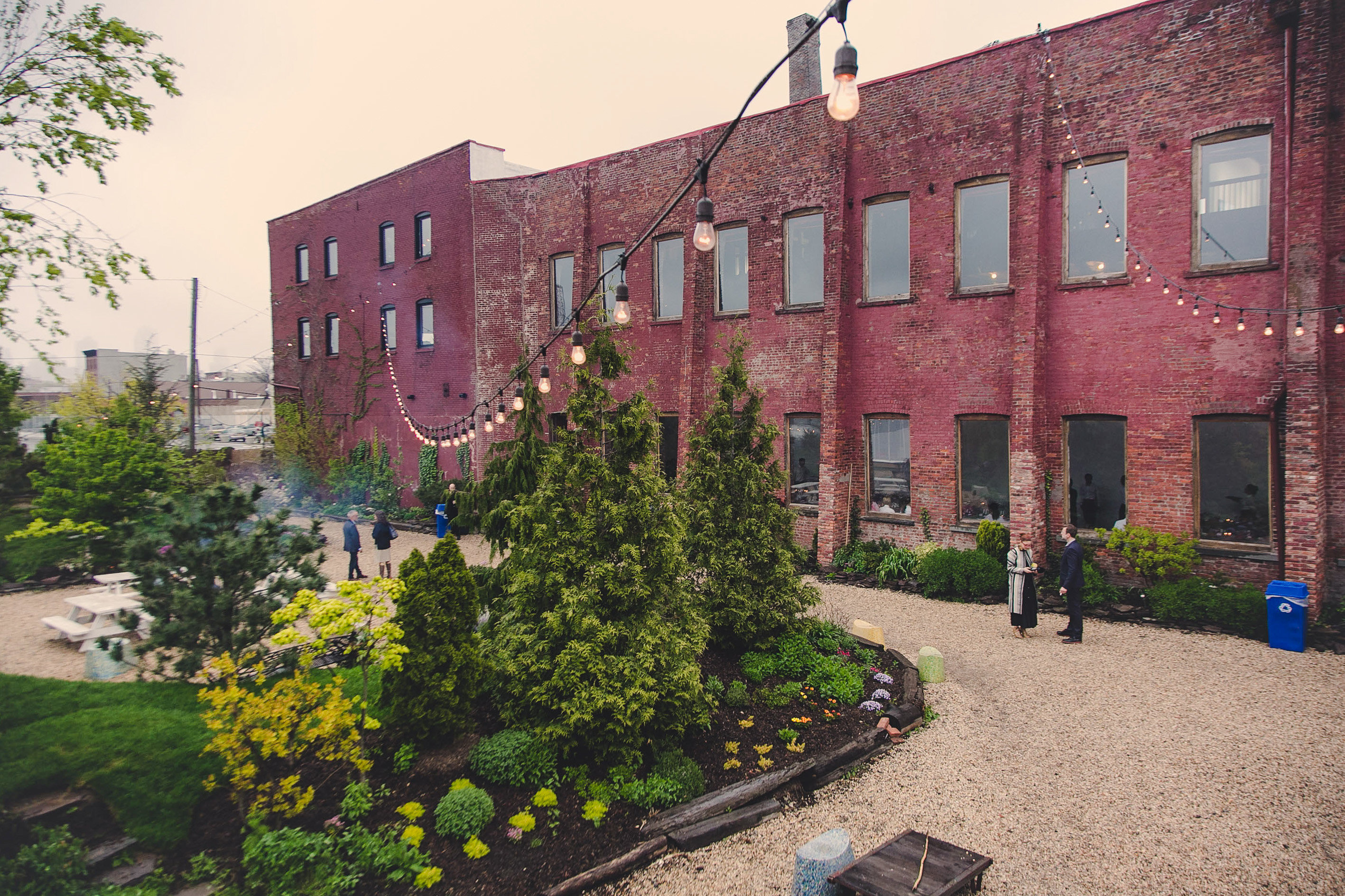 Arts + Culture Attractions Food + Drink Style + Design Travel Shop Trip Ideas tree outdoor neighbourhood building property Town house urban area Architecture plant home City residential area real estate campus estate Courtyard brick facade grass window apartment recreation Garden stone