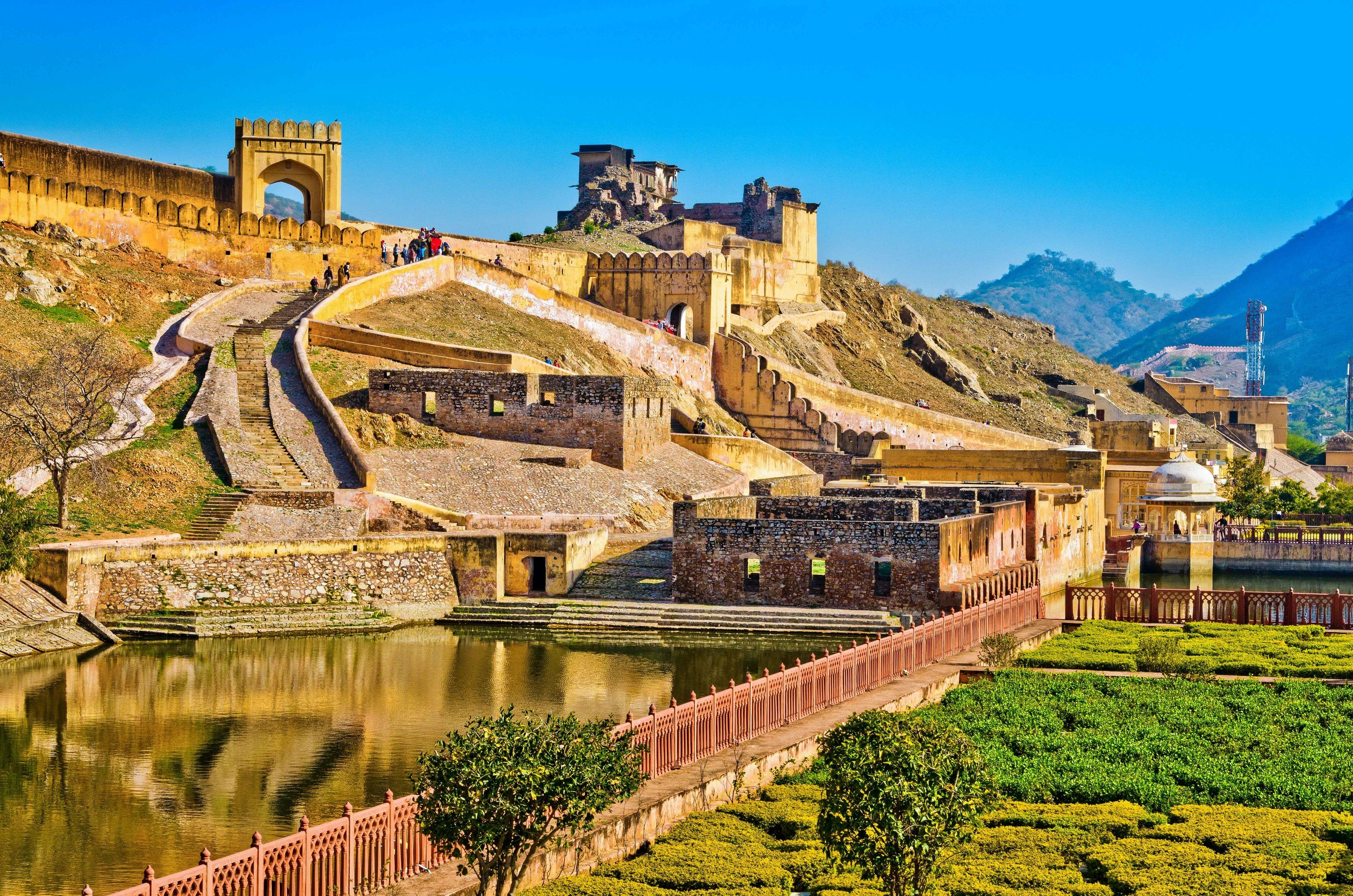 Travel Tips grass sky outdoor landmark historic site mountain tourist attraction mountain village Village real estate reflection tourism estate ancient history unesco world heritage site landscape City mount scenery archaeological site