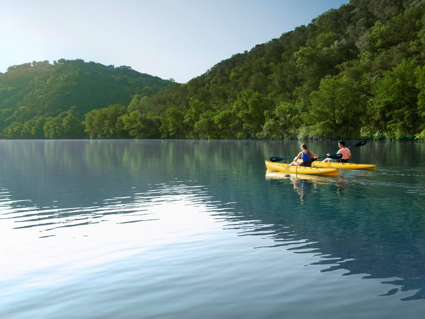 Hotels Lakes + Rivers water outdoor tree sky Boat vehicle Lake boating kayak kayaking mountain watercraft rowing canoe River watercraft sports equipment paddle reservoir surrounded