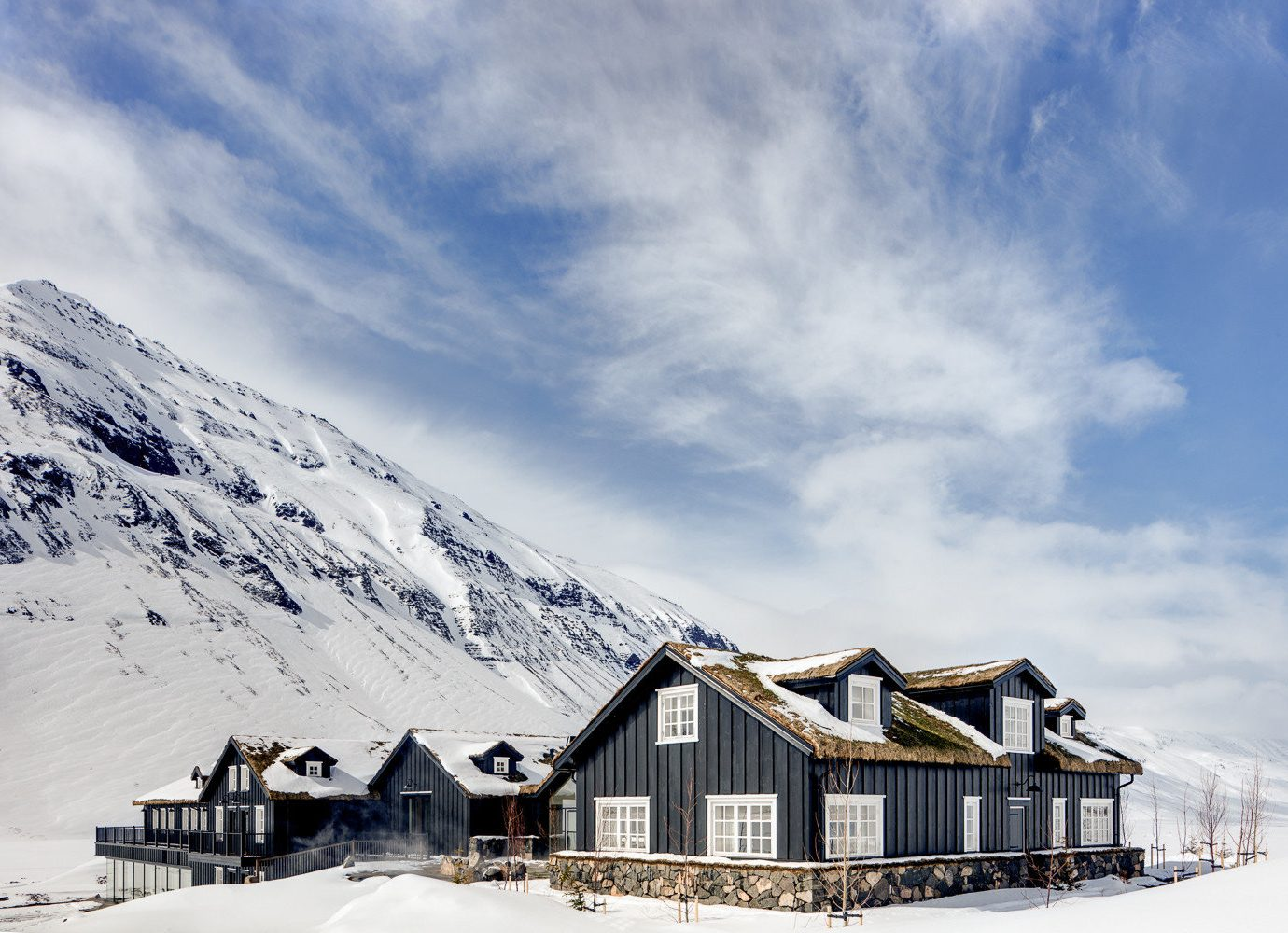 Boutique Hotels Hotels Outdoors + Adventure sky outdoor snow cloud Winter mountainous landforms mountain range mountain arctic alps house log cabin freezing home glacial landform hut elevation meteorological phenomenon fell landscape ice cottage tree roof day