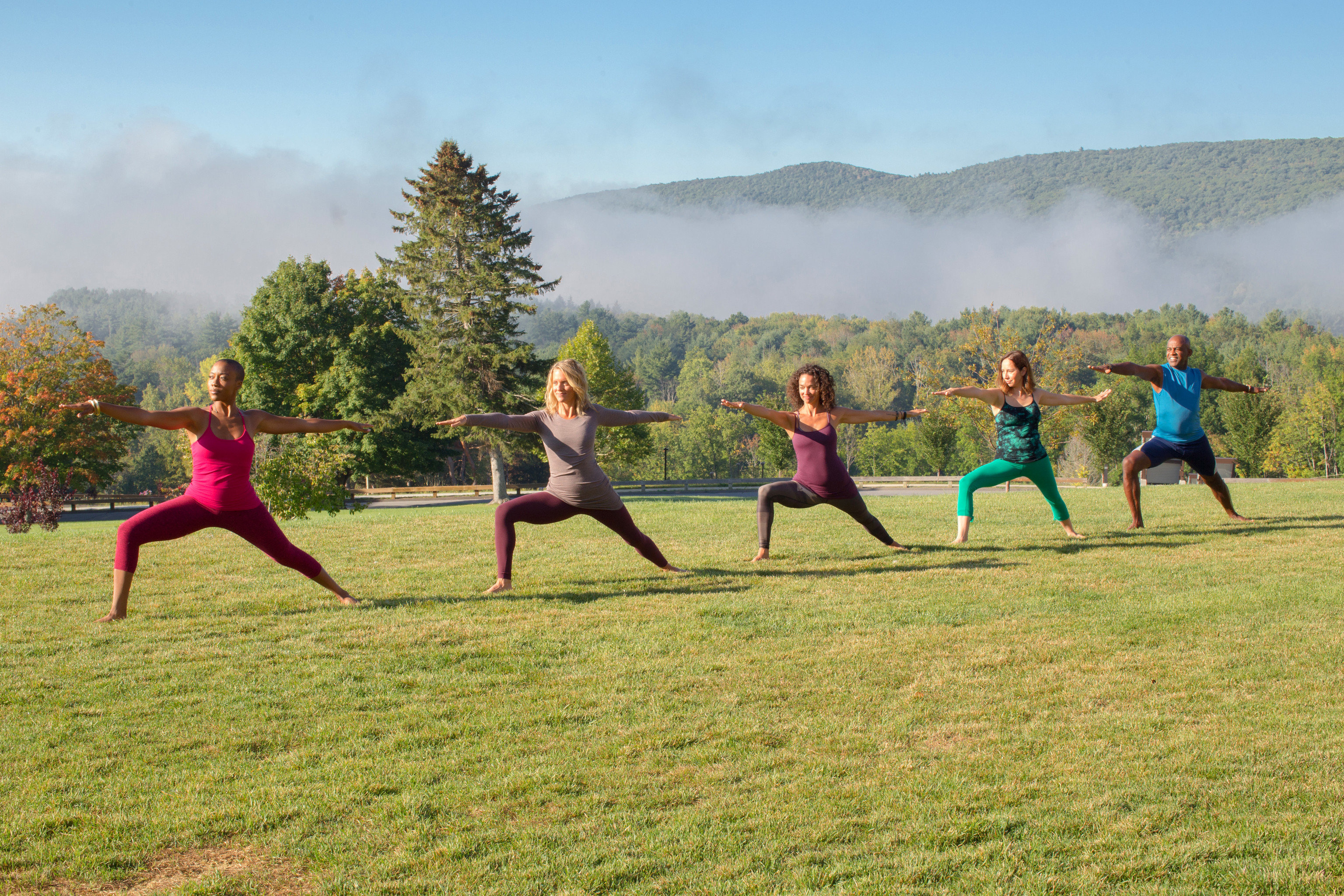 Health + Wellness Meditation Retreats Spa Retreats Trip Ideas Yoga Retreats grass sky outdoor human action field sports physical fitness Sport physical exercise