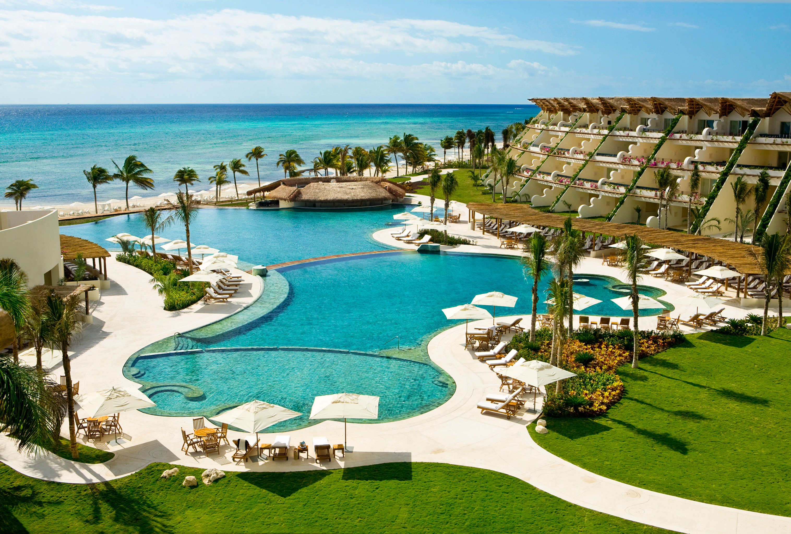 All-Inclusive Resorts Beachfront Elegant Family Travel Hotels Living Lounge Luxury Modern Pool Romance sky water outdoor grass umbrella swimming pool leisure Resort property chair estate lawn vacation caribbean bay mansion resort town Lagoon Villa lined