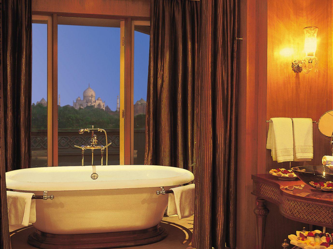 Hotels Luxury Travel indoor room window bathroom Suite interior design estate swimming pool bathtub old tub