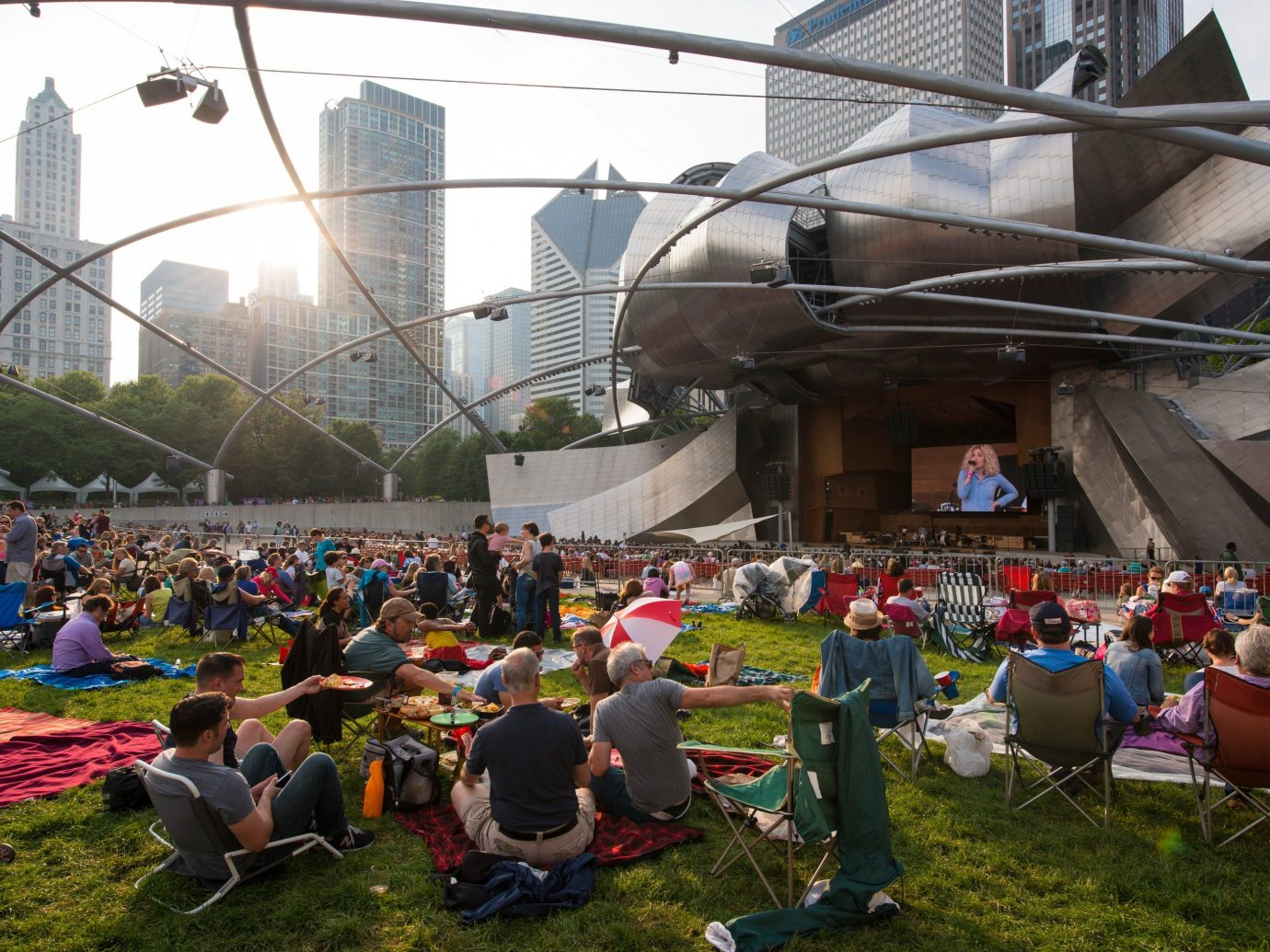Festivals + Events Offbeat Trip Ideas Yoga Retreats grass outdoor crowd sport venue people stadium arena festival