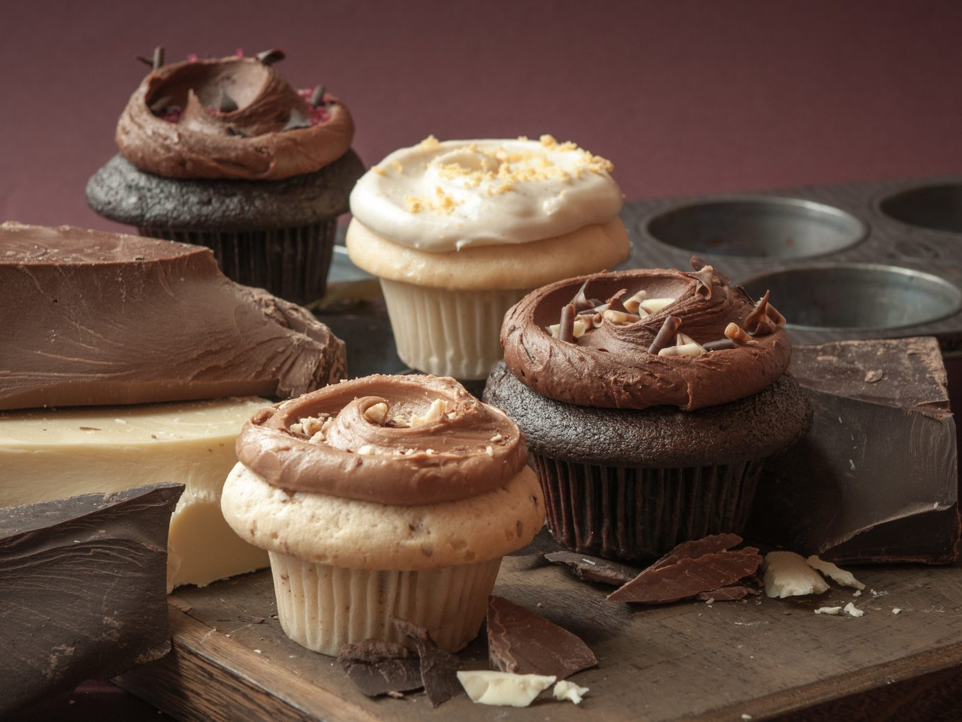Food + Drink food cupcake cake dessert buttercream icing chocolate wooden peanut butter cup baking sweetness flavor baked goods several