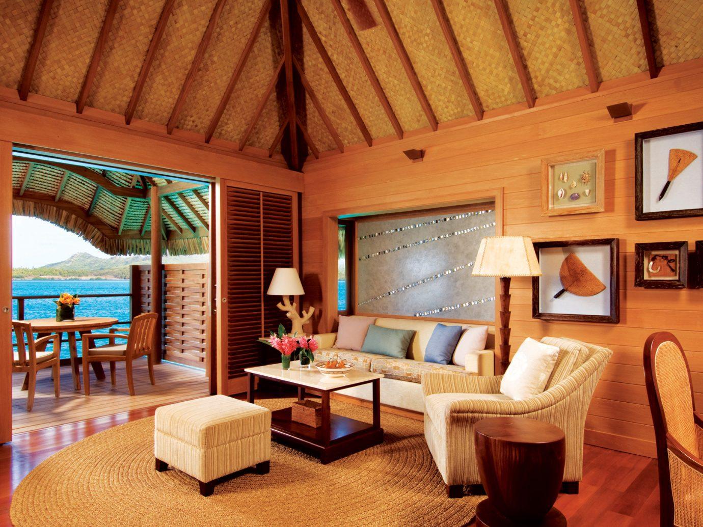 Hotels Living Luxury Trip Ideas floor indoor room property ceiling chair Resort estate cottage Villa living room interior design Suite real estate farmhouse furniture area decorated