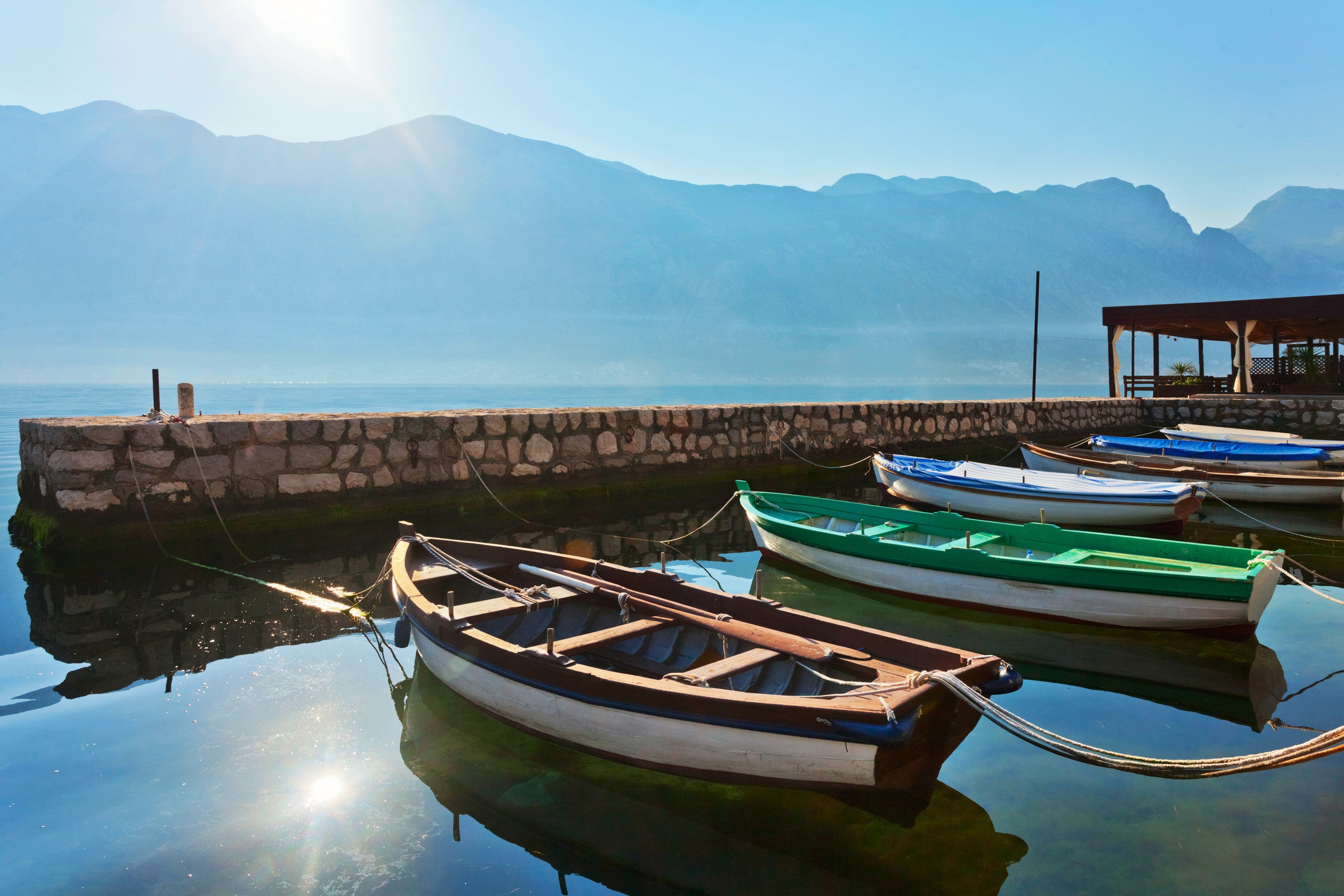 Romance Trip Ideas sky Boat water outdoor water transportation reflection mountain leisure Sea watercraft rowing boating tourism background vacation calm watercraft Resort landscape boats and boating equipment and supplies tied several