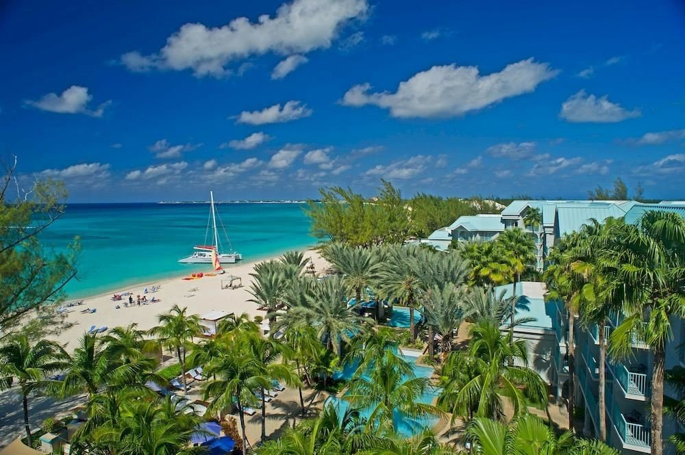 Hotels sky caribbean outdoor ecosystem Resort vacation Beach Nature Sea Coast bay tourism tropics Lagoon Ocean Island blue arecales estate plant shore