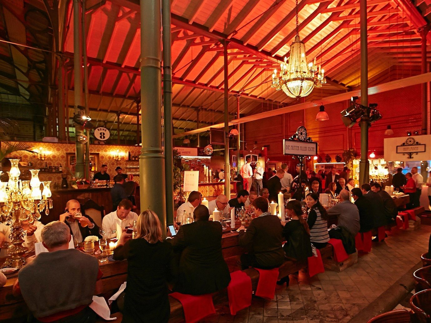 Food + Drink person people crowd ceiling meal group evening restaurant