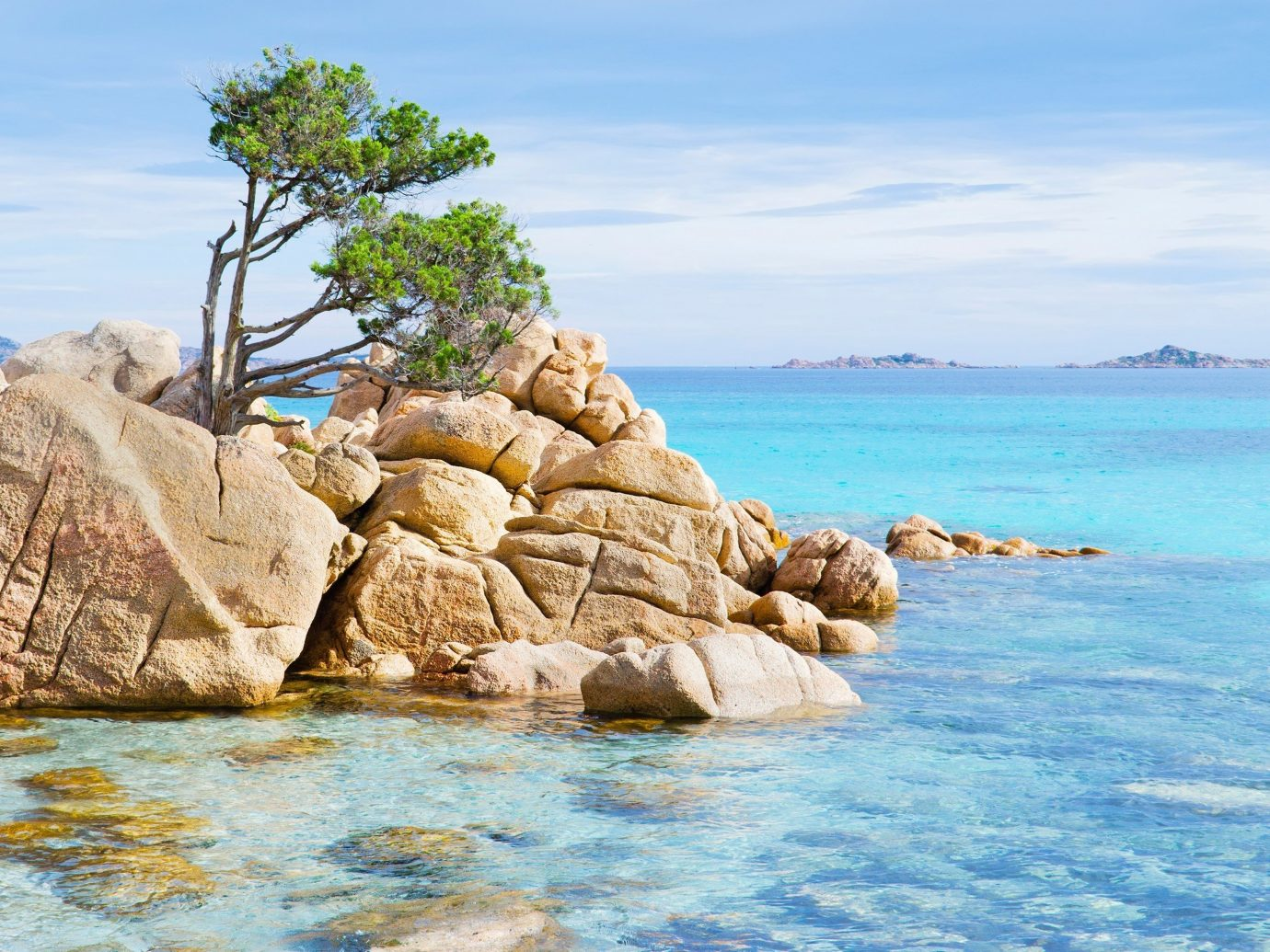 Offbeat sky water outdoor rock shore Nature Sea Coast body of water Beach Ocean vacation bay cove cape islet cliff terrain sand material